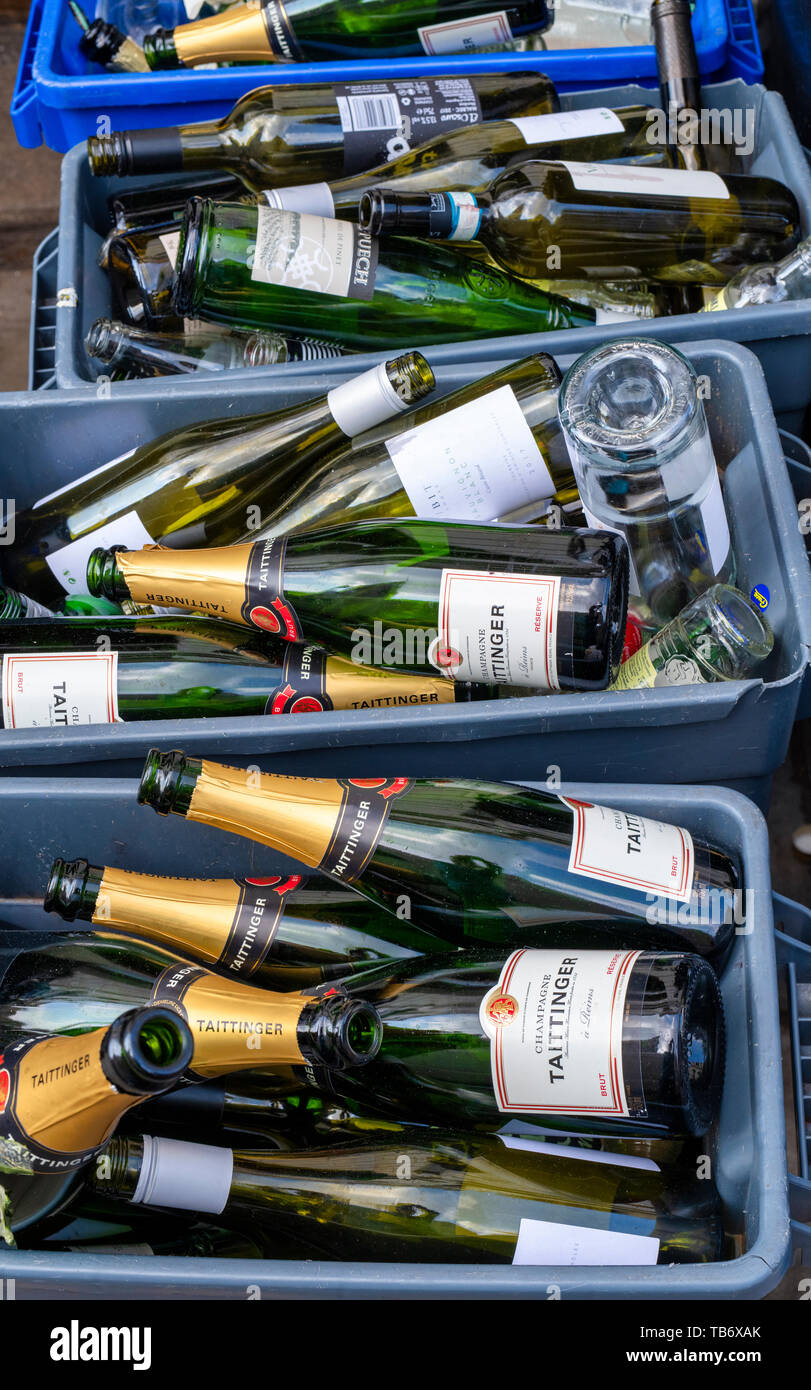 Empty taittinger champagne and wine bottles outside a london pub. Belgravia, London, England - Stock Image