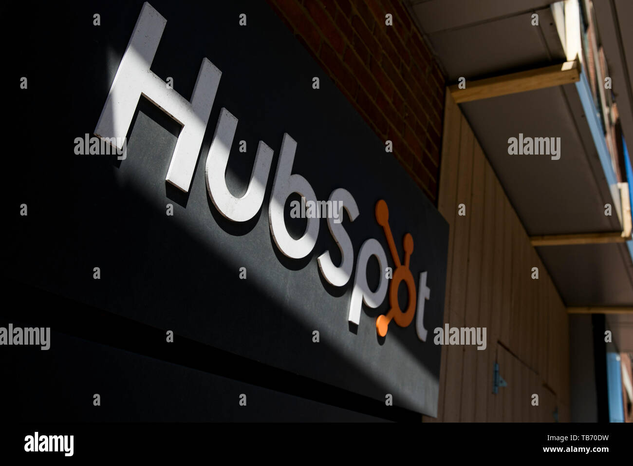 A logo sign outside of the headquarters of HubSpot in