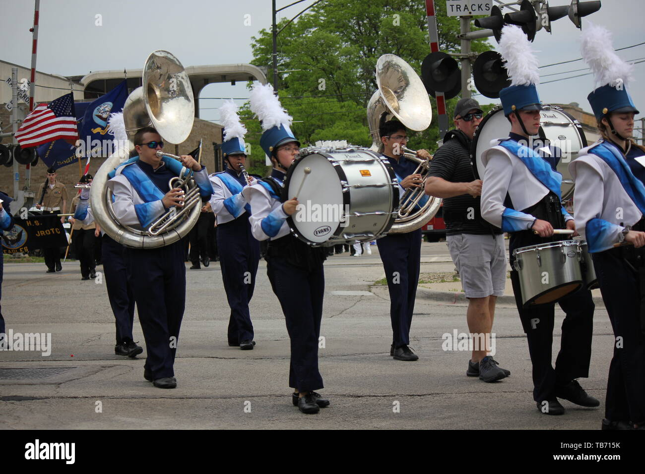 A local high school marching band playing in Chicago's Northwest side Memorial Day Parade. - Stock Image