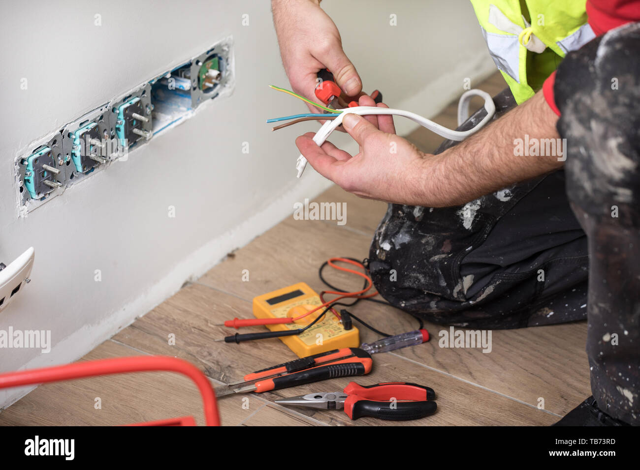 Electrician At Work Home Renovation Electrical Installation Hand Of An Electrician Stock Photo Alamy