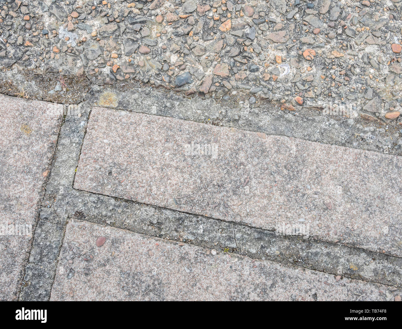 Badly fitting section of concrete paving. Metaphor 'a bad fit', gap filler, not fitting in, widening gap. - Stock Image