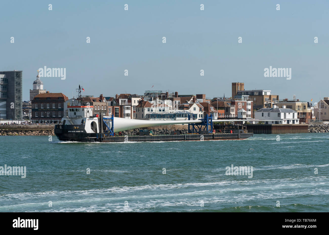 Portsmouth, England, UK. A deck cargo ship with a large wind turbine blade onboard. The MTB Blade Runner Two. - Stock Image