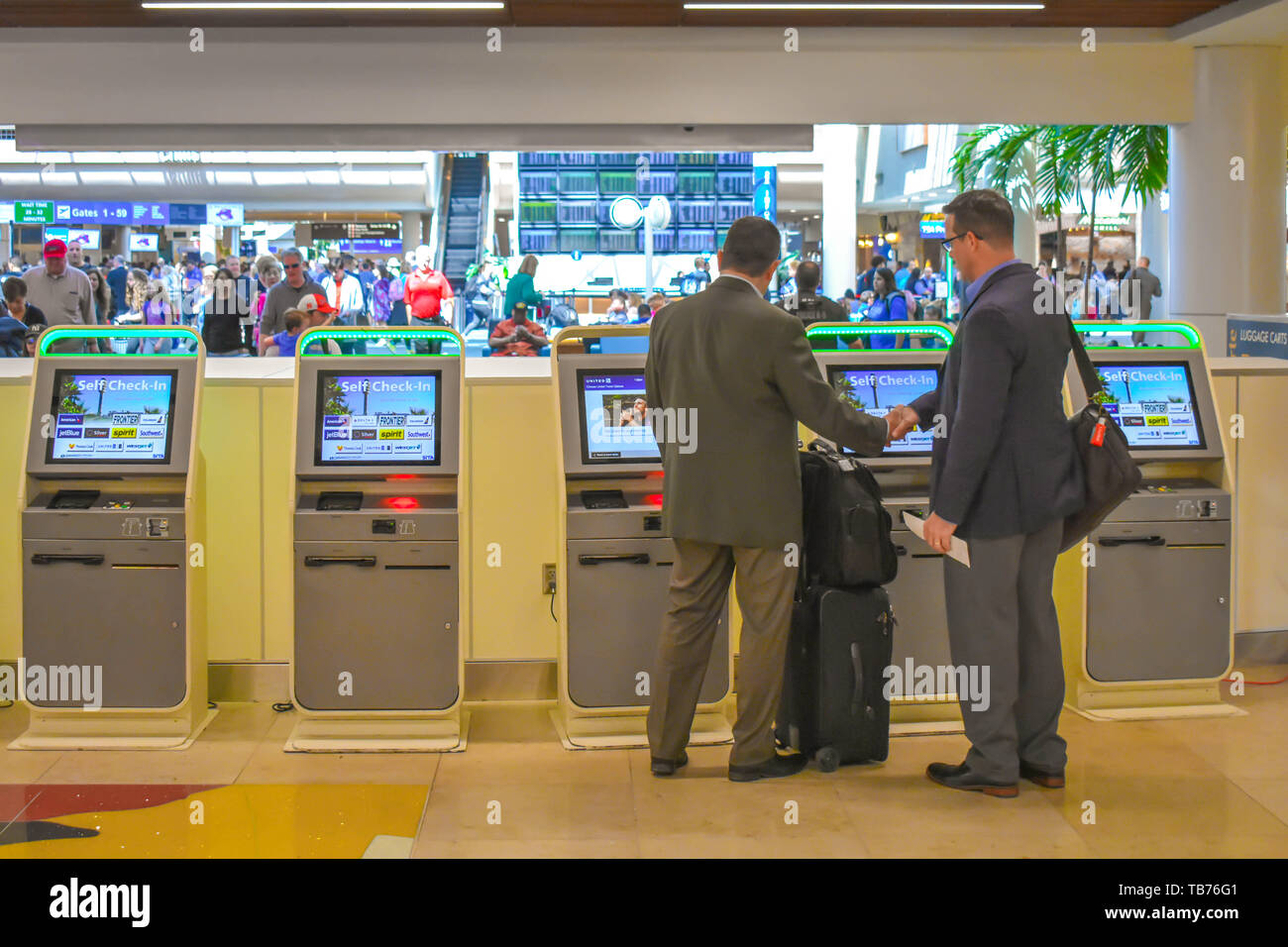 Orlando, Florida.  March 01, 2019. Businessman using Self service check-in at Orlando International Airport (2) - Stock Image