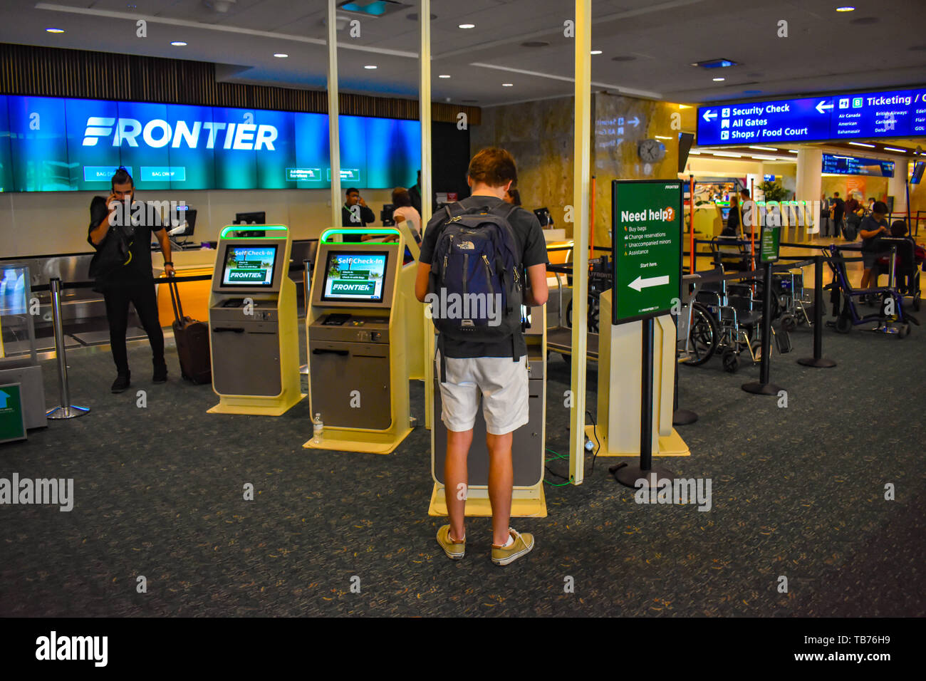 Orlando, Florida.  March 01, 2019. Man using Self service check-in at Orlando International Airport . - Stock Image