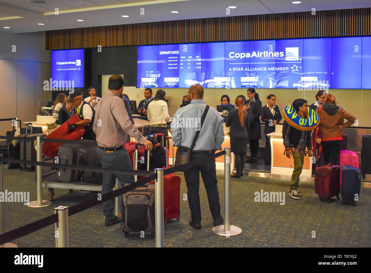 Orlando, Florida.  March 01, 2019. People doing check-in at Copa Airlines counter at Orlando International Airport . - Stock Image
