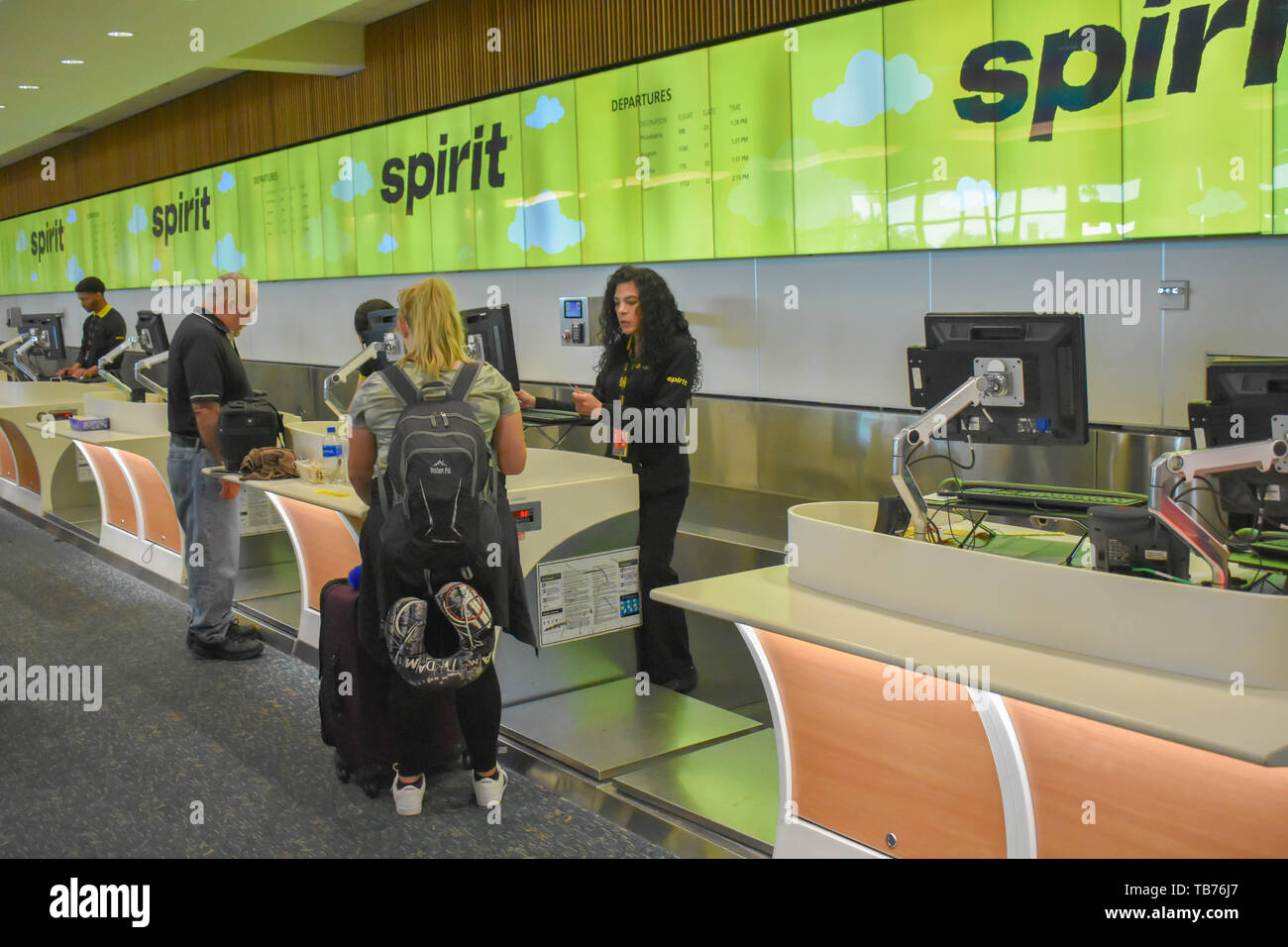 Orlando, Florida.  March 01, 2019. People doing check-in at Spirit Airlines counter in Orlando International Airport . - Stock Image