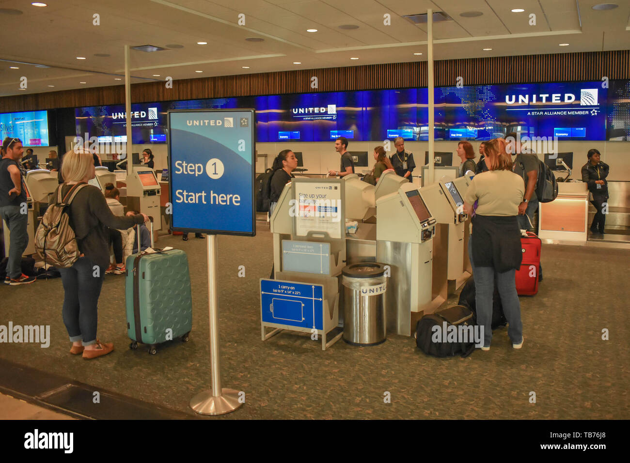 Orlando, Florida.  March 01, 2019. People using United Airlines Self service check-in at Orlando International Airport. - Stock Image