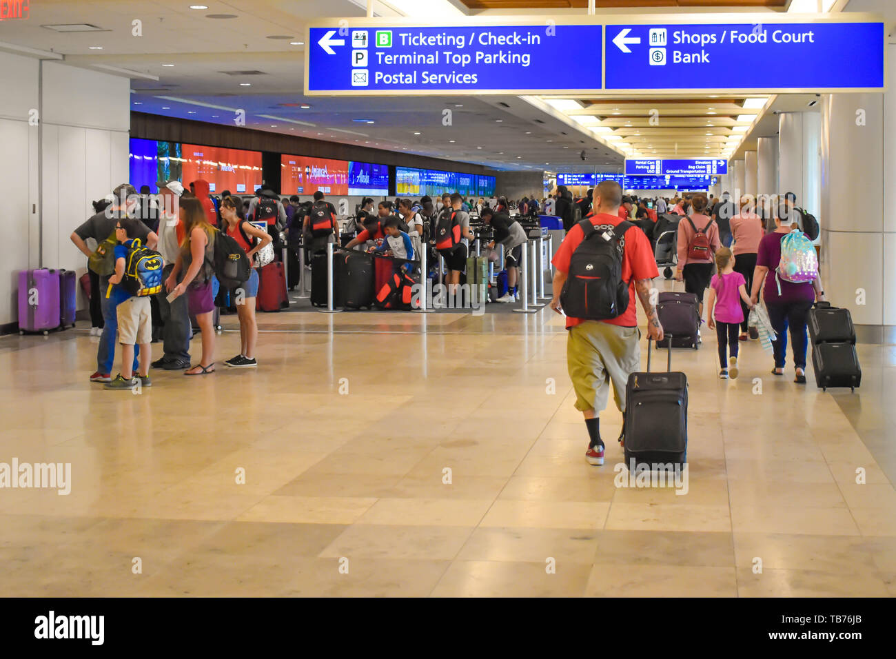 Orlando, Florida.  March 01, 2019. People walking in Check-in and Ticketing area at Orlando International Airport  (2) - Stock Image