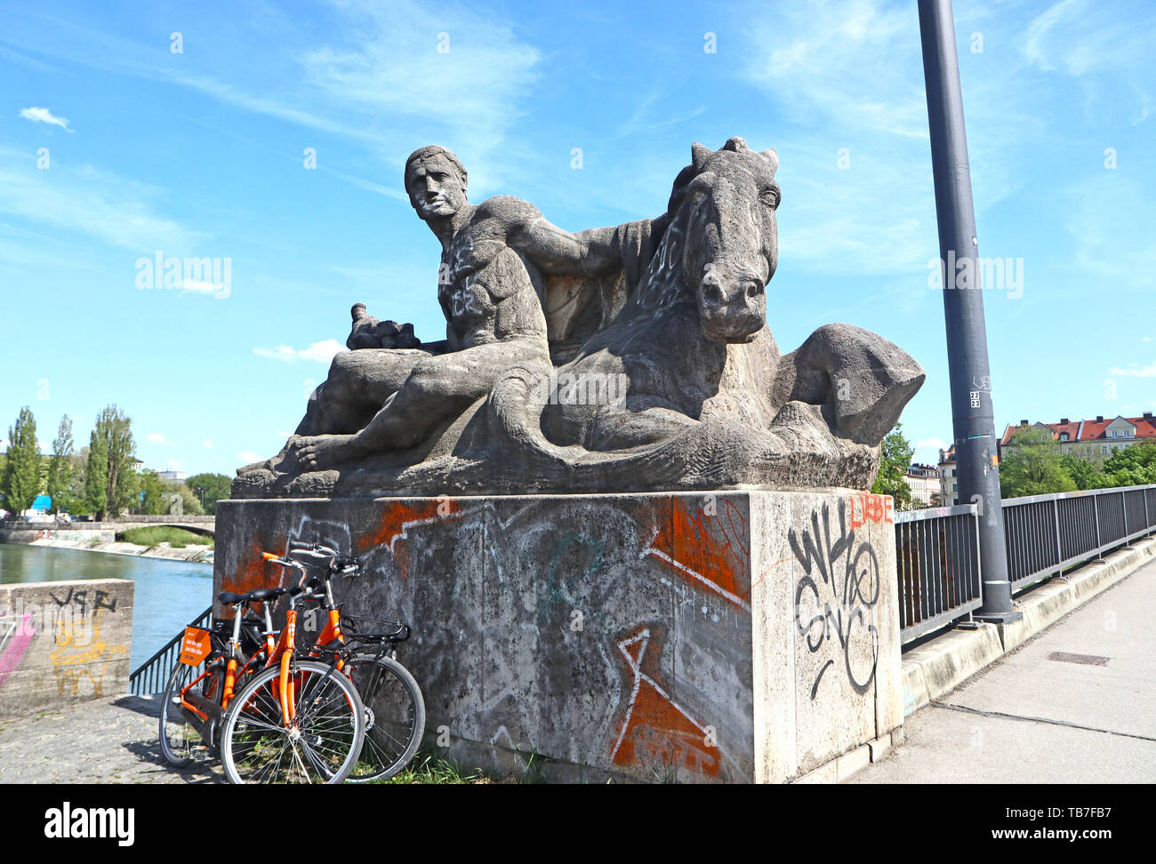 MUNICH, GERMANY - MAY 2, 2019 Sculpture group dated 1925 at the NW beginning of the Reichenbach bridge over the Isar river in Munich Stock Photo