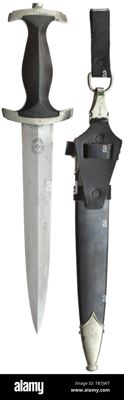A service dagger M 34 with Röhm dedication removed in accordance with the regulations, Herder, Solingen, Blade with perfectly preserved etched dedication, manufacturer's logo of Herder, Solingen on the reverse and removed Röhm dedication. Nickel silver grip fittings, the upper one with struck SS service number '103088', the quillons with stamped 'I'. Black wooden grip with inlaid national eagle and enamelled SS emblem. Steel scabbard with black finish and nickel silver fittings. Vertical steep hanger of black leather, stamped 'SS 48/34 RZM' on the inside, the clip with Assm, Editorial-Use-Only - Stock Image