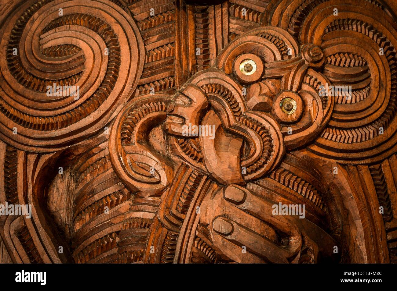 figure face traditional maori carving in the assembly hall te whare runanga waitangi far north district northland north island new zealand TB7M8C