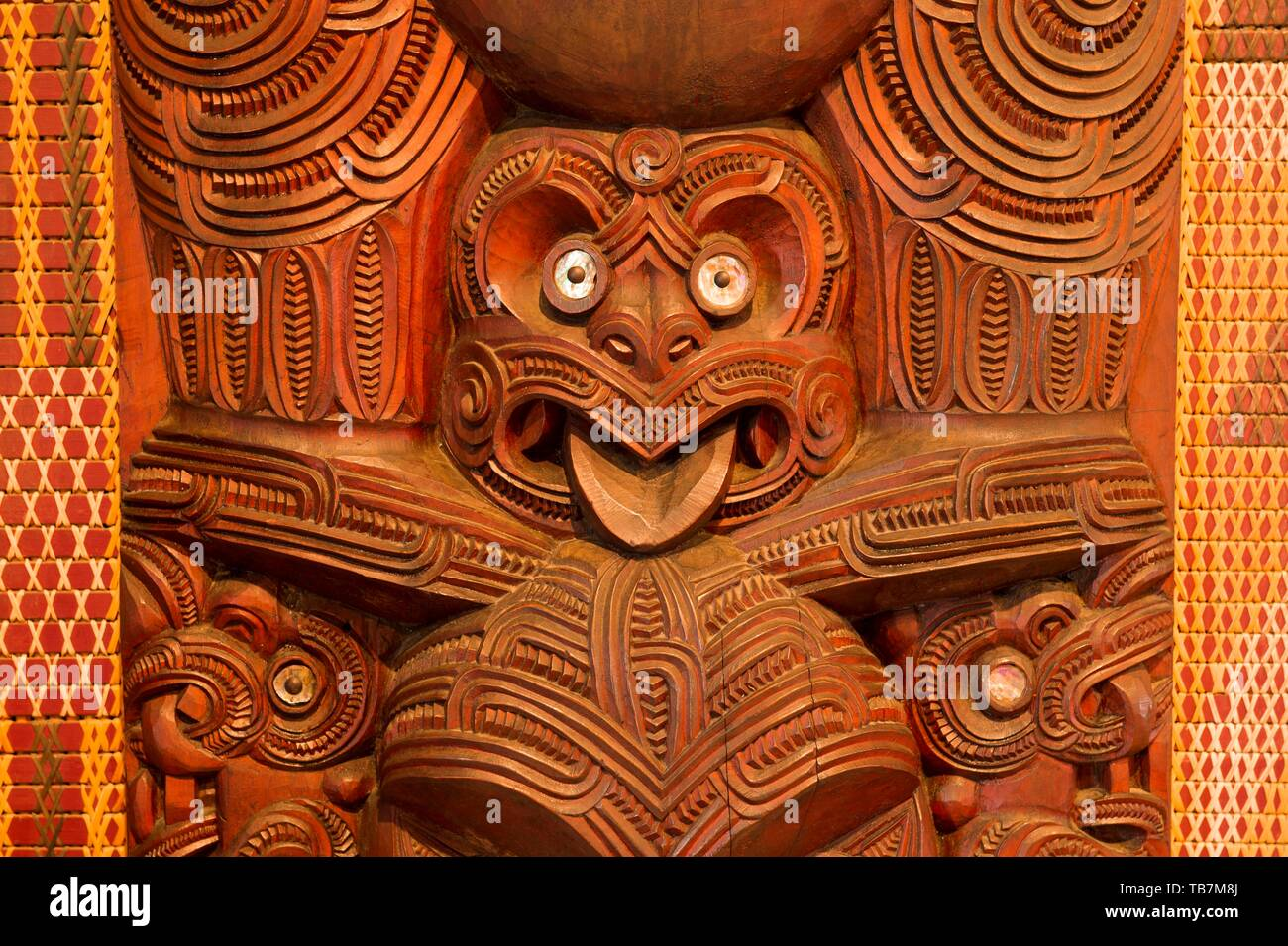 figure face traditional maori carving in the assembly hall te whare runanga waitangi far north district northland north island new zealand TB7M8J