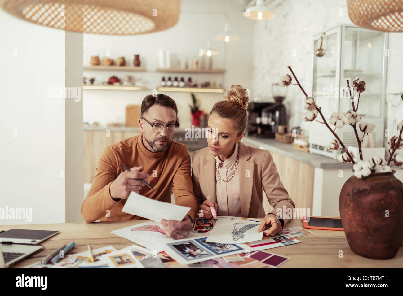 Team Work Creative Fashion Designer Discussing Sketches Of His New Collection With His Assistant Stock Photo Alamy