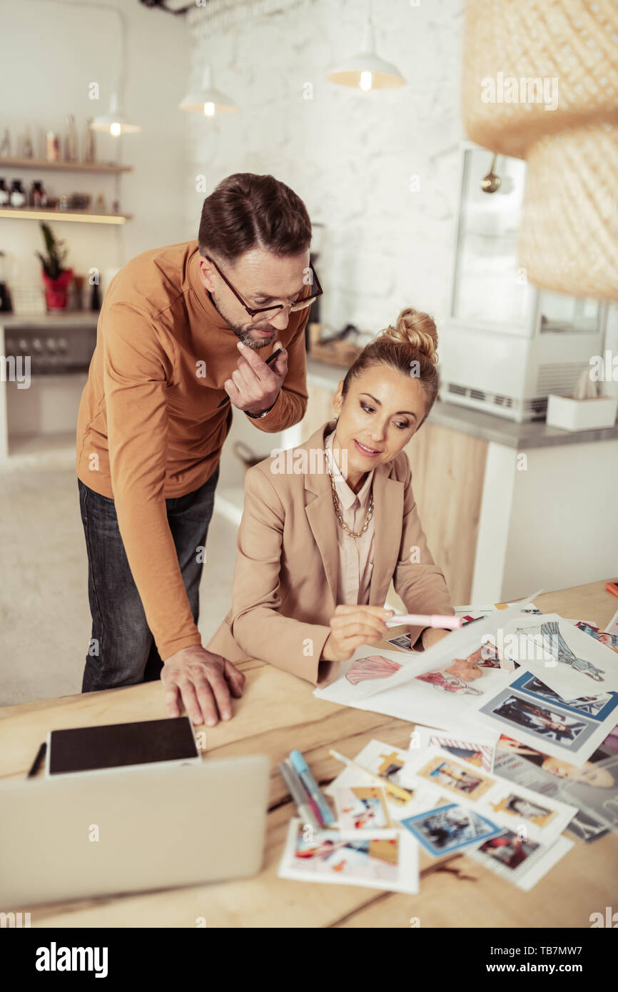 New Ideas Focused Fashion Designer And His Smiling Assistant Working On Creation Of New Clothes Stock Photo Alamy