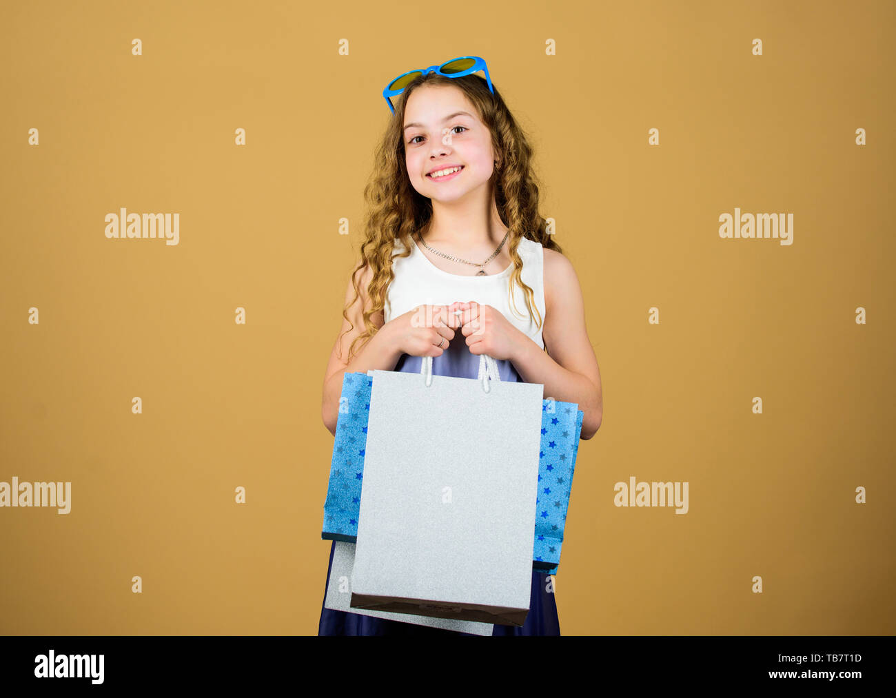 Successful shopping. cyber Monday. Present and gifts buy. black Friday discount. happy birthday holiday. Beauty. happy shopping girl with bags. summer sales. Small girl fashion. - Stock Image