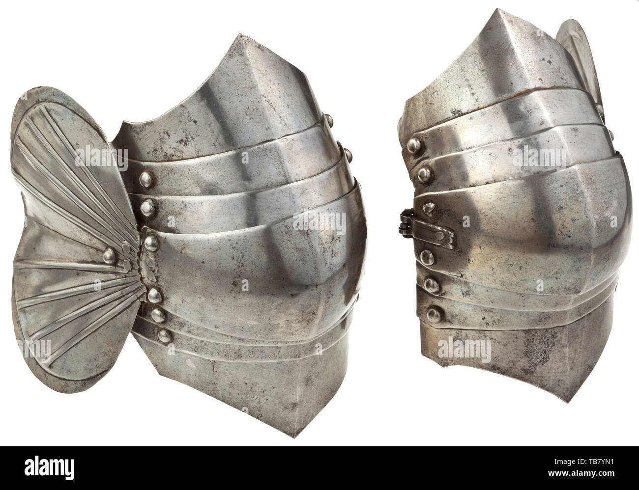 A pair of poleyns for a German Maximilian armour, comprehensively circa 1515 - 1520, For the greater part matching, each formed with a low medial ridge, the central plates each with a hasp riveted over the external surface and carrying a later buckle, each fitted with a separate wing over the outer joint of the knee, each with recessed edges and embossed with two fans of four segmental ridges about a V-shaped gutter, and with three articulated lames top and bottom, the three upper and lower lames each with strongly cusped edges. The upper and low, Additional-Rights-Clearance-Info-Not-Available - Stock Image