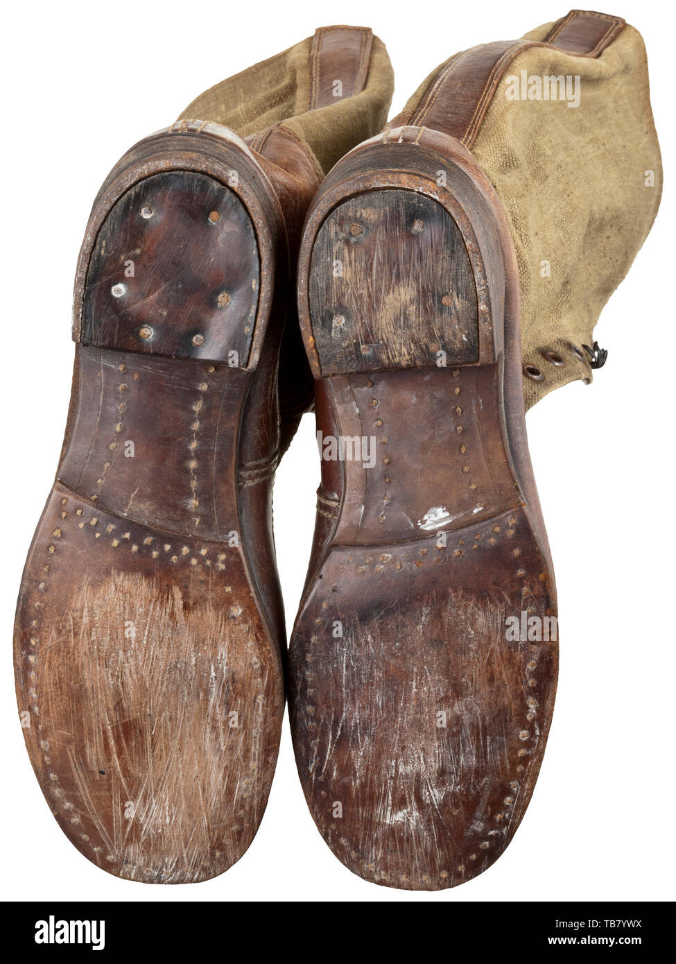A pair of lace-up boots to the tropical uniform, Depot pieces. Soles and reinforcements in brown leather, brown canvas shafts with brown painted iron eyelets and hooks (filmed with rust), linen lining stamped with the size and the manufacturer's mark. Welted leather soles with wooden pegs. Slight signs of wear. historic, historical 20th century, Additional-Rights-Clearance-Info-Not-Available Stock Photo