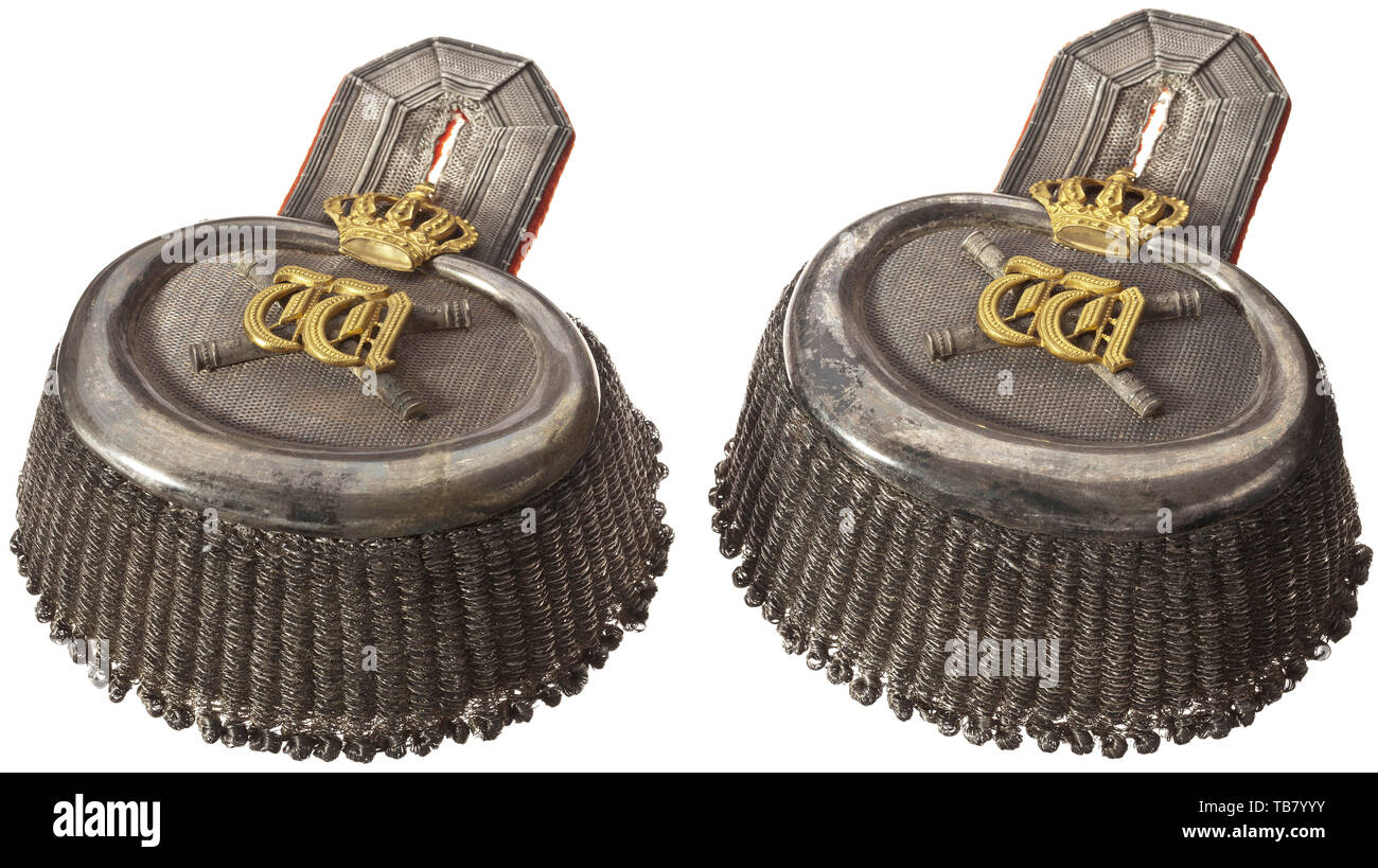 A pair of personal epaulettes belonging to the German Emperor Wilhelm II, as Generalfeldmarschall and Commander of the 1st Foot Guard Regiment, The epaulettes with silver textured fields and crescents. Superimposed are the silver field marshall's batons and the crowned gilt cypher 'W', which adorned all shoulder pieces and epaulettes worn by the Kaiser. Rigid silver fringes, with a red cloth backing. A shoulder pad fixed to the bottom of the left epaulette to disguise Wilhelm's physical impediment. The epaulettes with signs of wear and a beautifu, Additional-Rights-Clearance-Info-Not-Available - Stock Image