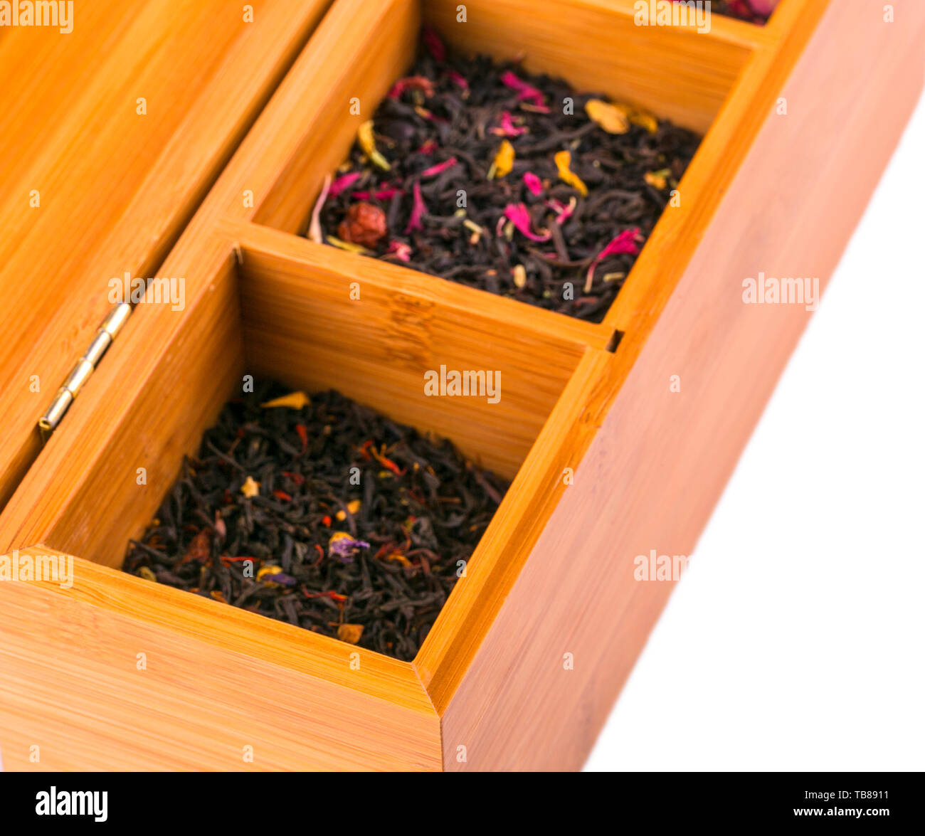 Assortment Of Dry Tea In Wooden Box Isolated On White Background