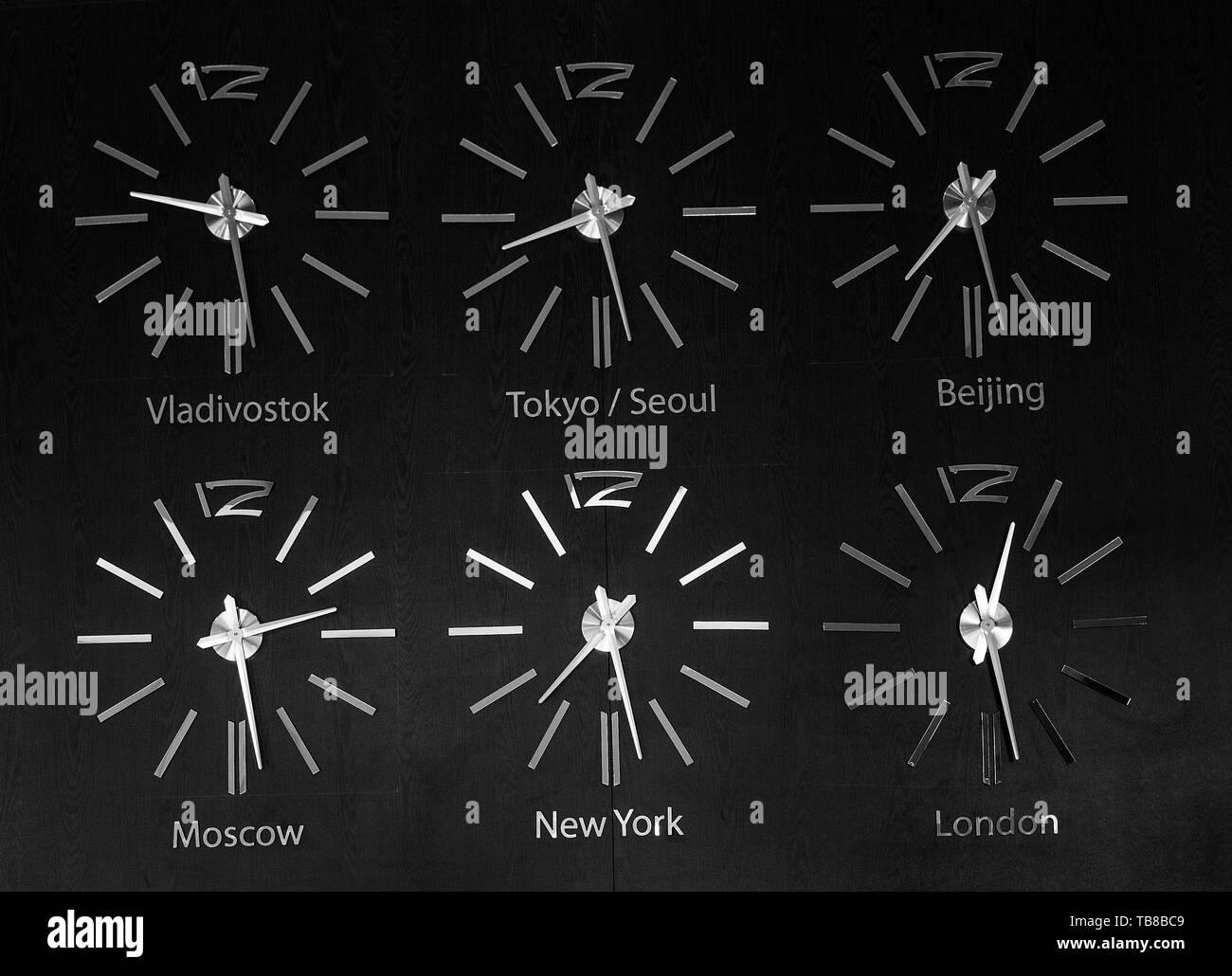 Timezone clocks in hotel - Stock Image