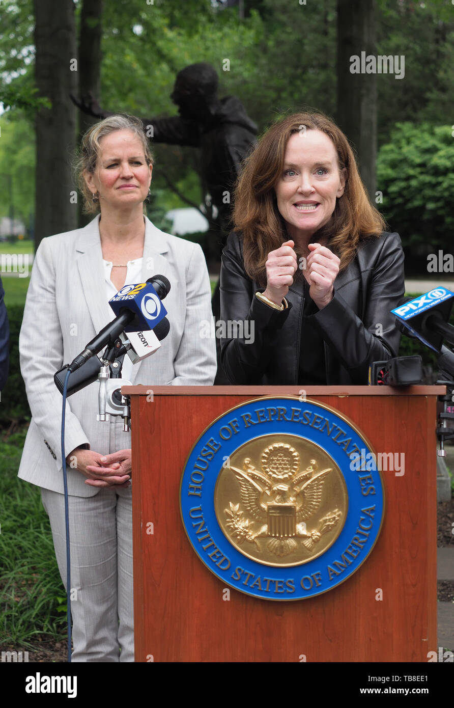 Hempstead, New York, USA. 30th May, 2019. At podium, U.S. Representative KATHLEEN RICE (NY-04) clenches her fists during her press conference to announce she's introducing Three Bills to Congress to combat Impaired and distracted Driving, and at left is Nassau County Executive LAURA CURRAN, who thanked Rep. Rice for her safe driving legislation. Congresswoman Rice announced the package of 3 bills - End Drunk Driving Act, the Prevent Impaired Driving Child Endangerment Act, and the Distracted Driving Education Act of 2019 - at the Drunk Driving Victims Memorial in Eisenhower Park. (Cr Stock Photo