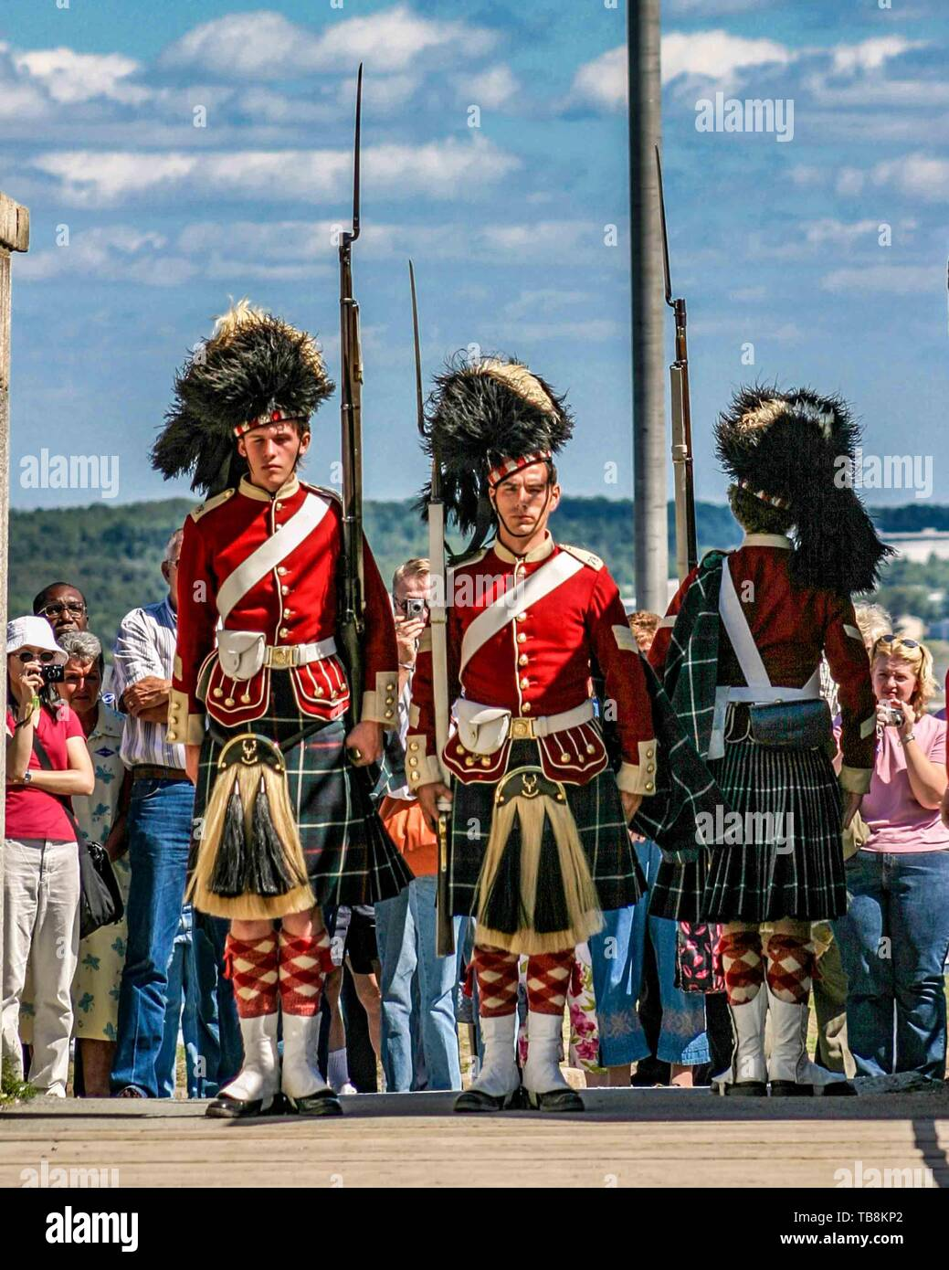 Halifax, Nova Scotia, Canada. 5th Sep, 2005. Tourists watch a changing of the guard by re-enactors dressed as soldiers of the 78th Highland Regiment, on Citadel Hill (Fort George), a National Historic Site in Halifax, Nova Scotia. A living history museum, the fort is among the most visited sites in Atlantic Canada. Credit: Arnold Drapkin/ZUMA Wire/Alamy Live News - Stock Image