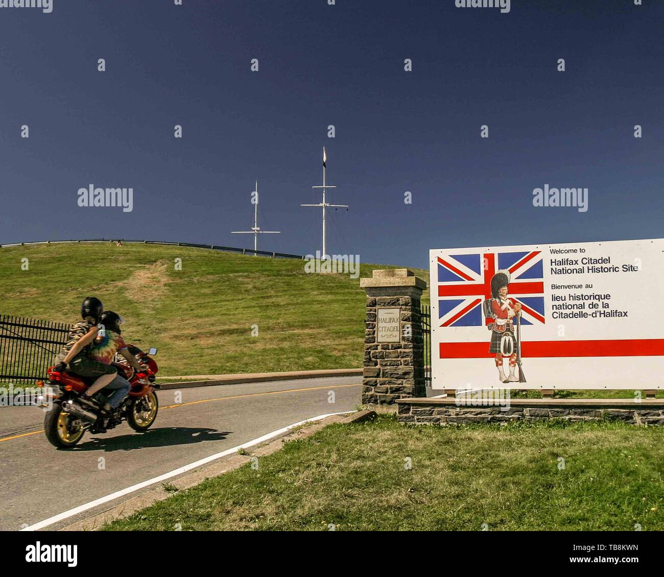 Halifax, Nova Scotia, Canada. 5th Sep, 2005. A tourist couple on a motorbike enter the Halifax Citadel on Citadel Hill (Fort George), a National Historic Site in Halifax, Nova Scotia. A living history museum, the fort is among the most visited sites in Atlantic Canada. Credit: Arnold Drapkin/ZUMA Wire/Alamy Live News - Stock Image