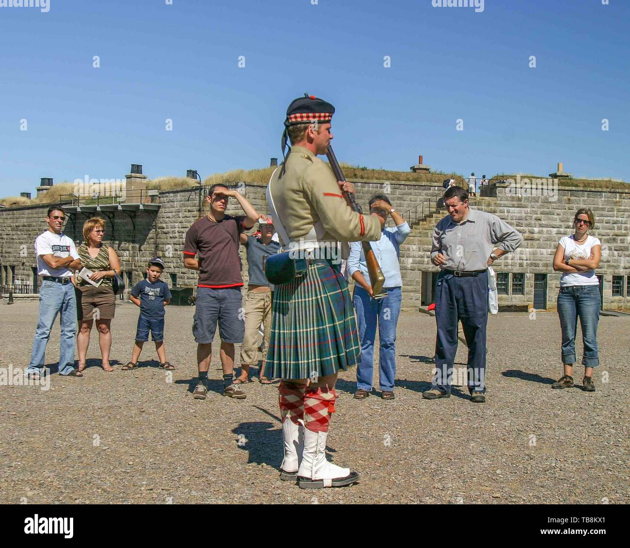 Halifax, Nova Scotia, Canada. 5th Sep, 2005. A re-enactor dressed in the uniform of the 78th Highlanders performs a presentation for tourists on Citadel Hill (Fort George), a National Historic Site in Halifax, Nova Scotia. A living history museum, the fort is among the most visited sites in Atlantic Canada. Credit: Arnold Drapkin/ZUMA Wire/Alamy Live News - Stock Image