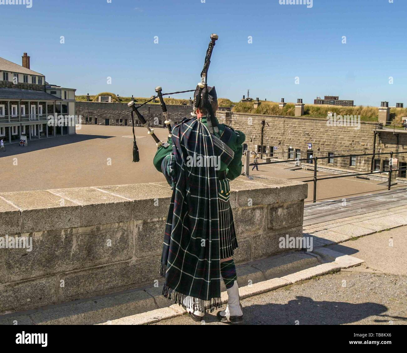 Halifax, Nova Scotia, Canada. 5th Sep, 2005. A re-enactor of the 78th Highlanders Pipe Band plays the bagpipe on Citadel Hill (Fort George), a National Historic Site in Halifax, Nova Scotia. A living history museum, the fort is among the most visited sites in Atlantic Canada. Credit: Arnold Drapkin/ZUMA Wire/Alamy Live News - Stock Image