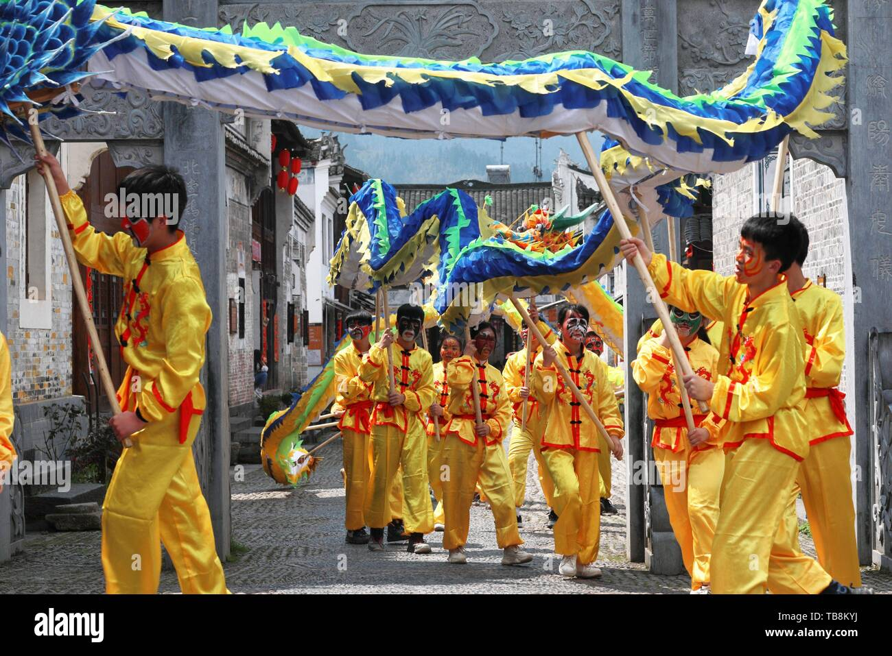(190531) -- BEIJING, May 31, 2019 (Xinhua) -- Students of Longli Middle and Primary School perform Longli's dragon dance in the ancient town of Longli in Jinping County, southwest China's Guizhou Province, on March 20, 2019. Classified as an intangible cultural heritage of Guizhou Province in 2005, Longli's dragon dance has a history of more than 600 years. China has set up a nationwide intangible cultural heritage protection network comprising 2,467 institutions and 17,308 personnel as of the end of 2018, according to a government report. These institutions sponsored about 65,500 related p - Stock Image