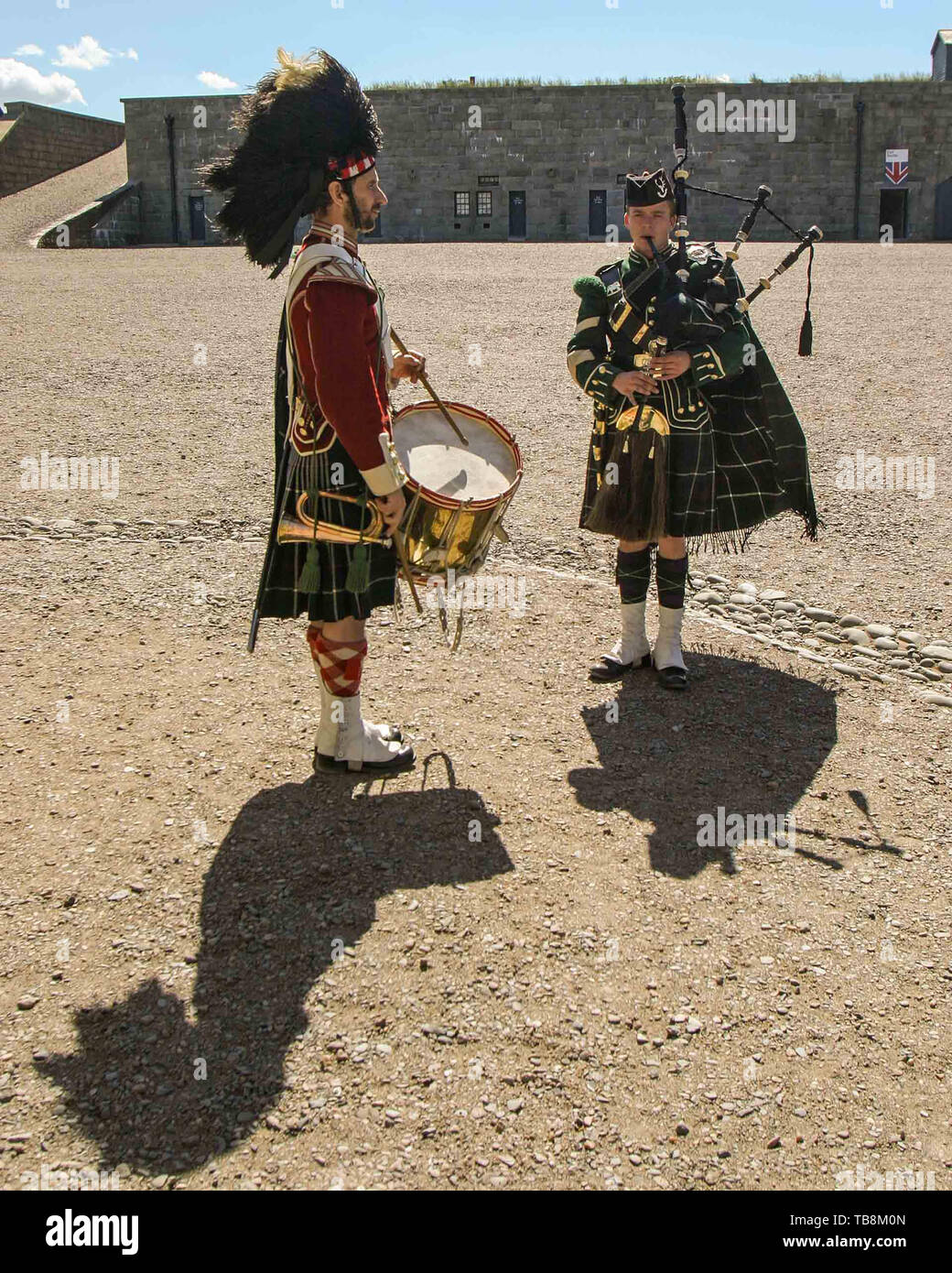 Halifax, Nova Scotia, Canada. 5th Sep, 2005. Drummer and piper re-enactors, dressed in the uniforms of the 78th Highlanders, perform for tourists on Citadel Hill (Fort George), a National Historic Site in Halifax, Nova Scotia. A living history museum, the fort is among the most visited sites in Atlantic Canada. Credit: Arnold Drapkin/ZUMA Wire/Alamy Live News - Stock Image