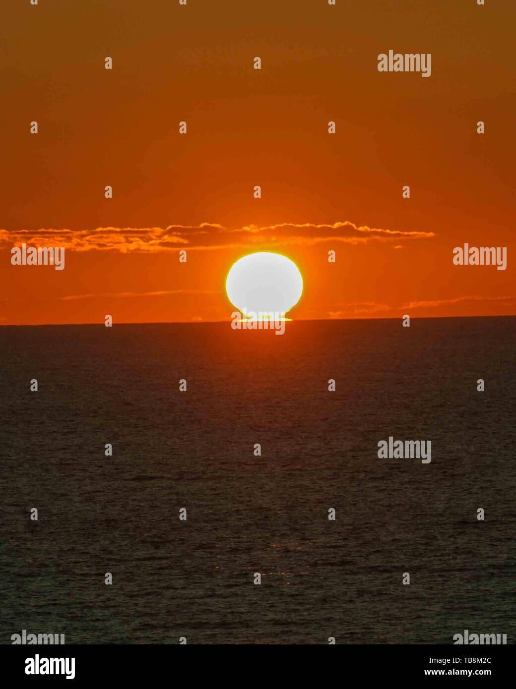 Halifax, Nova Scotia, Canada. 5th Sep, 2005. The sun sets into the Atlantic Ocean off the coast of Nova Scotia near the city of Halifax. Credit: Arnold Drapkin/ZUMA Wire/Alamy Live News - Stock Image