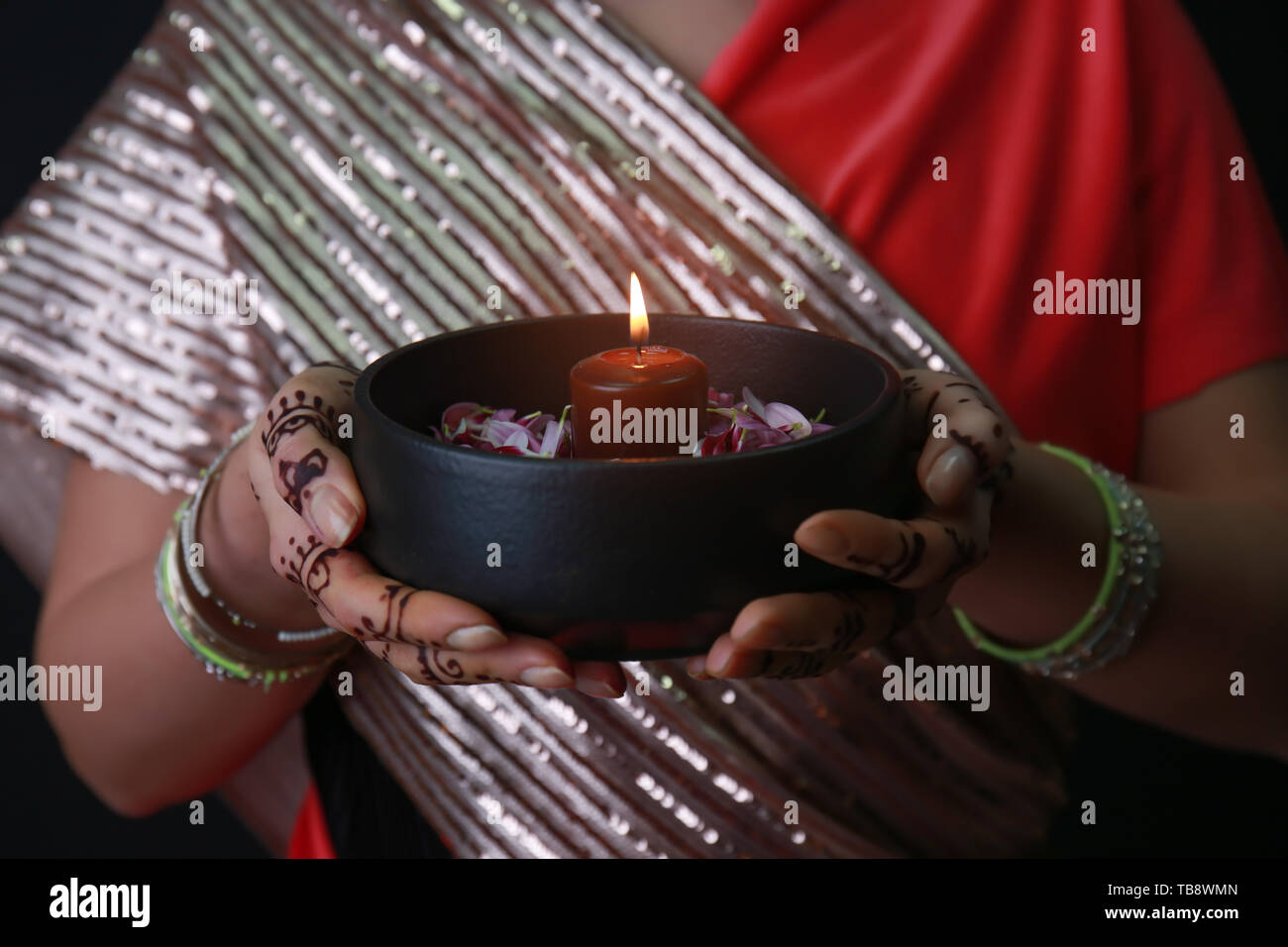 Beautiful woman with burning candle for celebration of Divaly, closeup Stock Photo