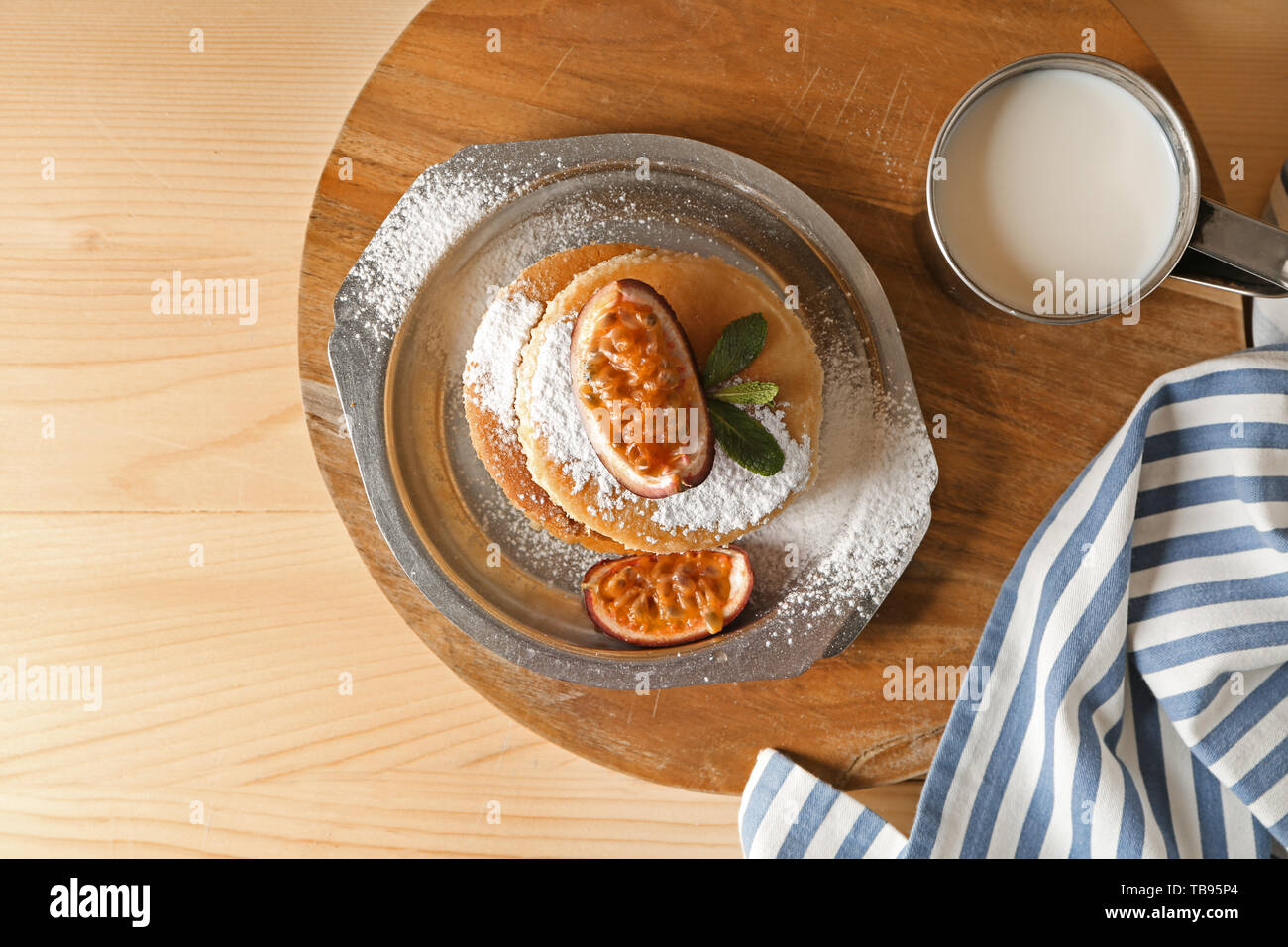 Tasty Pancakes With Passion Fruit And Mug Of Milk On Table Stock Photo Alamy