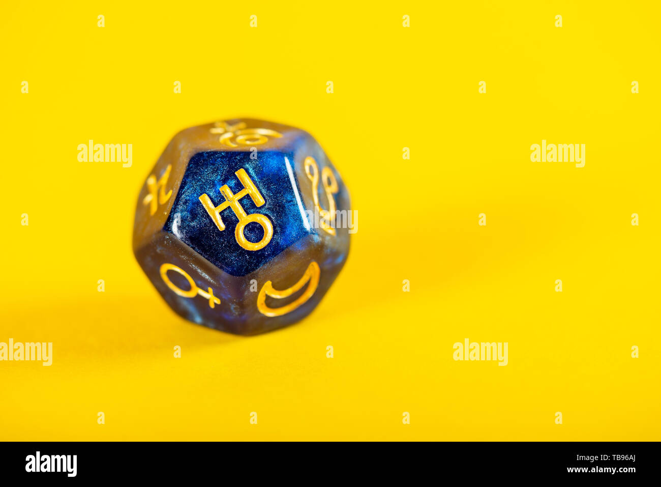 Astrology Dice with symbol of the planet Uranus on Yellow