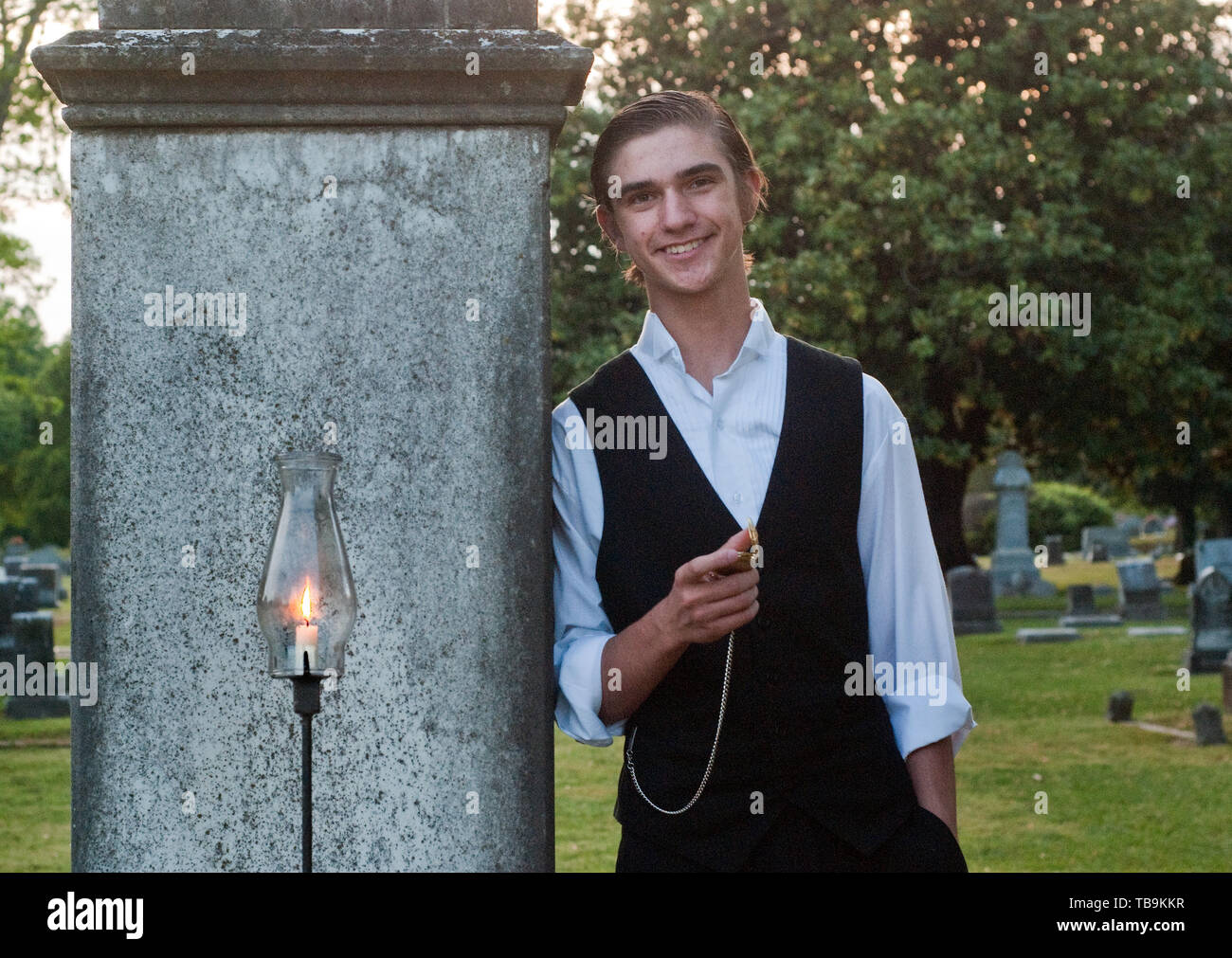 A teenager portrays a local character during 'Tales from the Crypt,' held at Friendship Cemetery in Columbus, Mississippi, April 16, 2010. - Stock Image