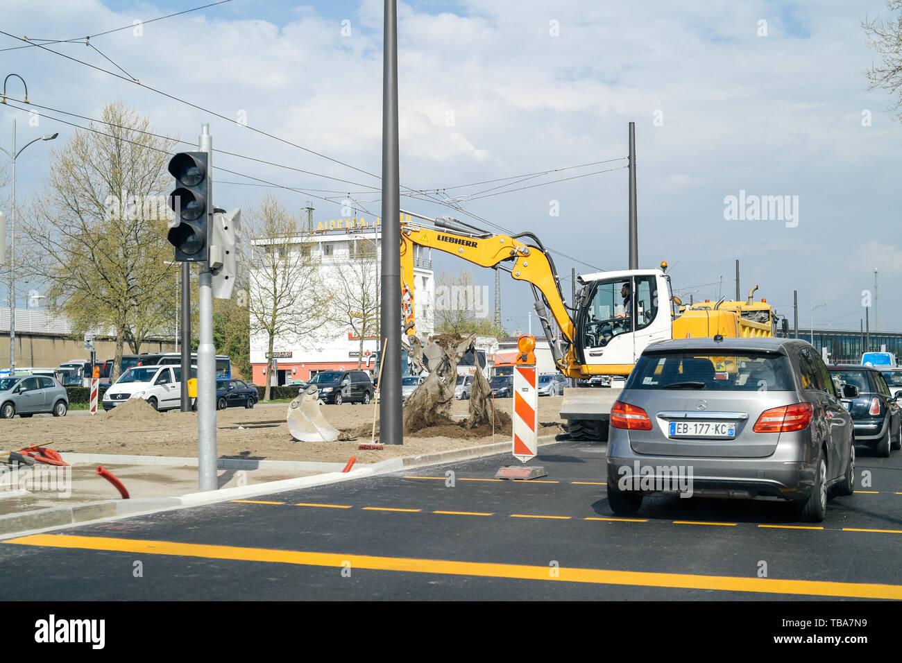 Kehl, Germany - Apr 4, 2017: Liebherr excavator working on roadworks installing new tramway rail in central German Kehl city Stock Photo