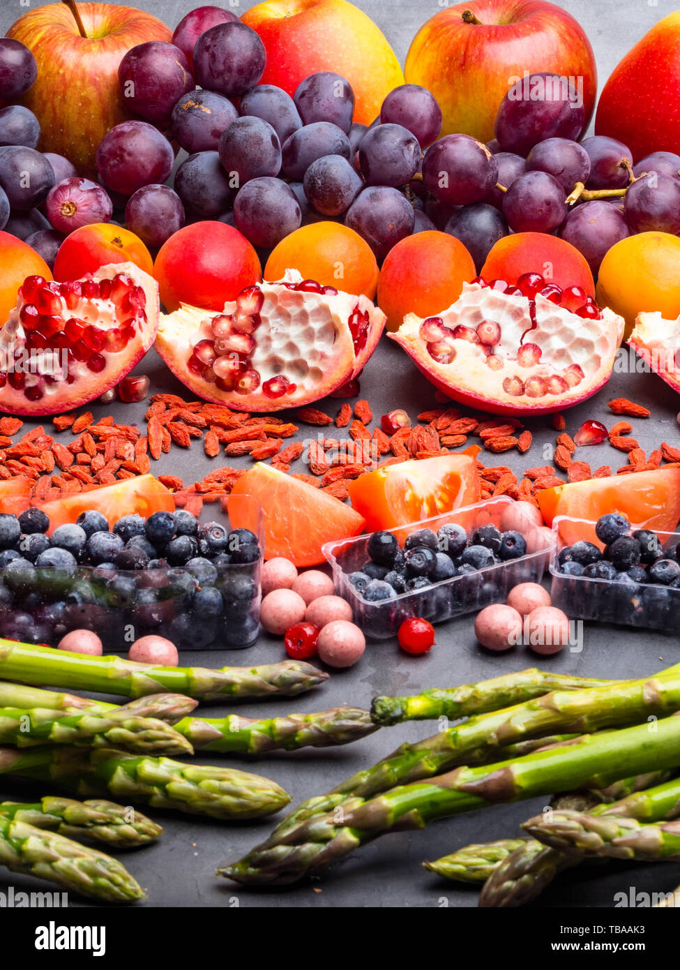 Healthy Eating Background Food Different Fruits Asparagus Berry Resveratrol Vitamin Rich Food On Concrete Background Above View Stock Photo Alamy
