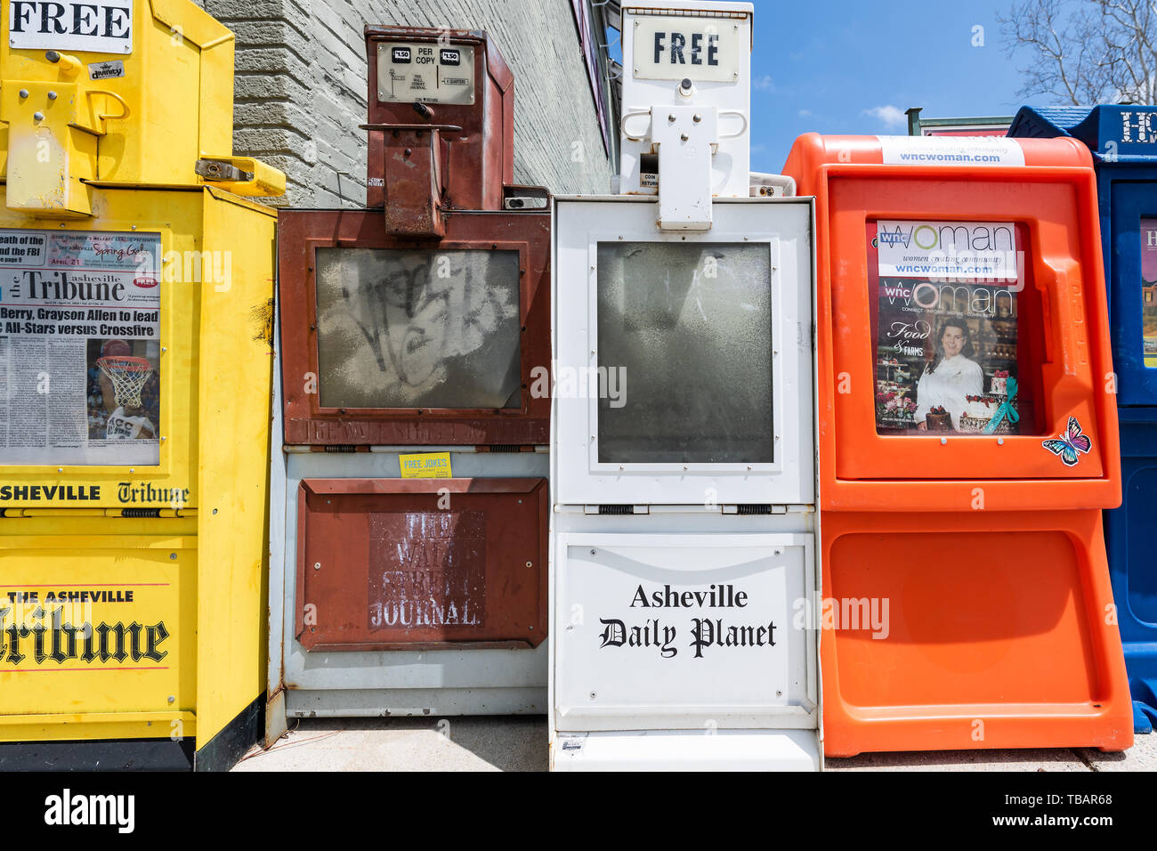 Asheville, USA - April 19, 2018: Downtown old town street in hipster North Carolina NC famous town with sign for newspaper kiosk stand - Stock Image