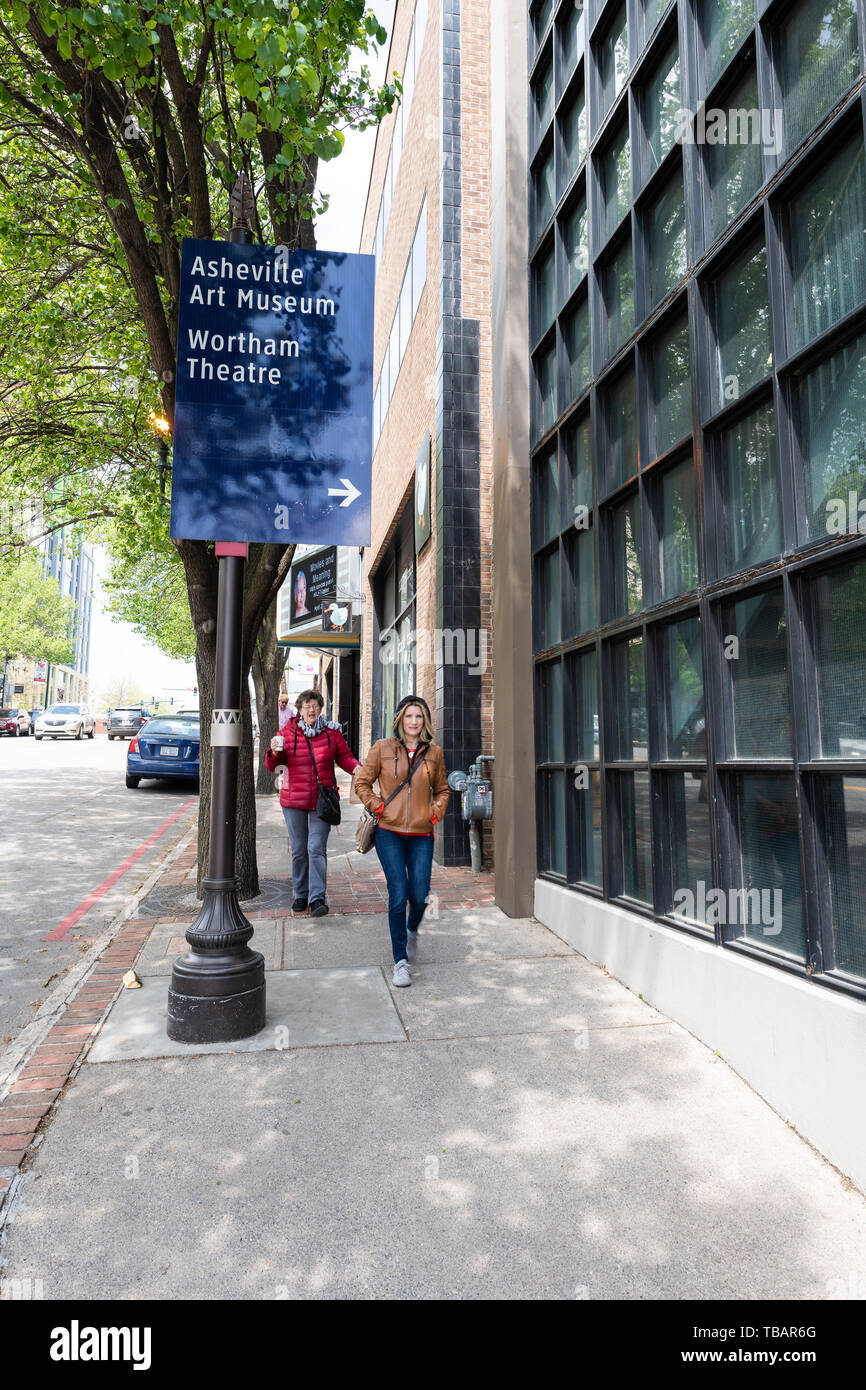 Asheville, USA - April 19, 2018: Downtown old town street in North Carolina NC famous town city with sign for art museum and wortham theatre - Stock Image