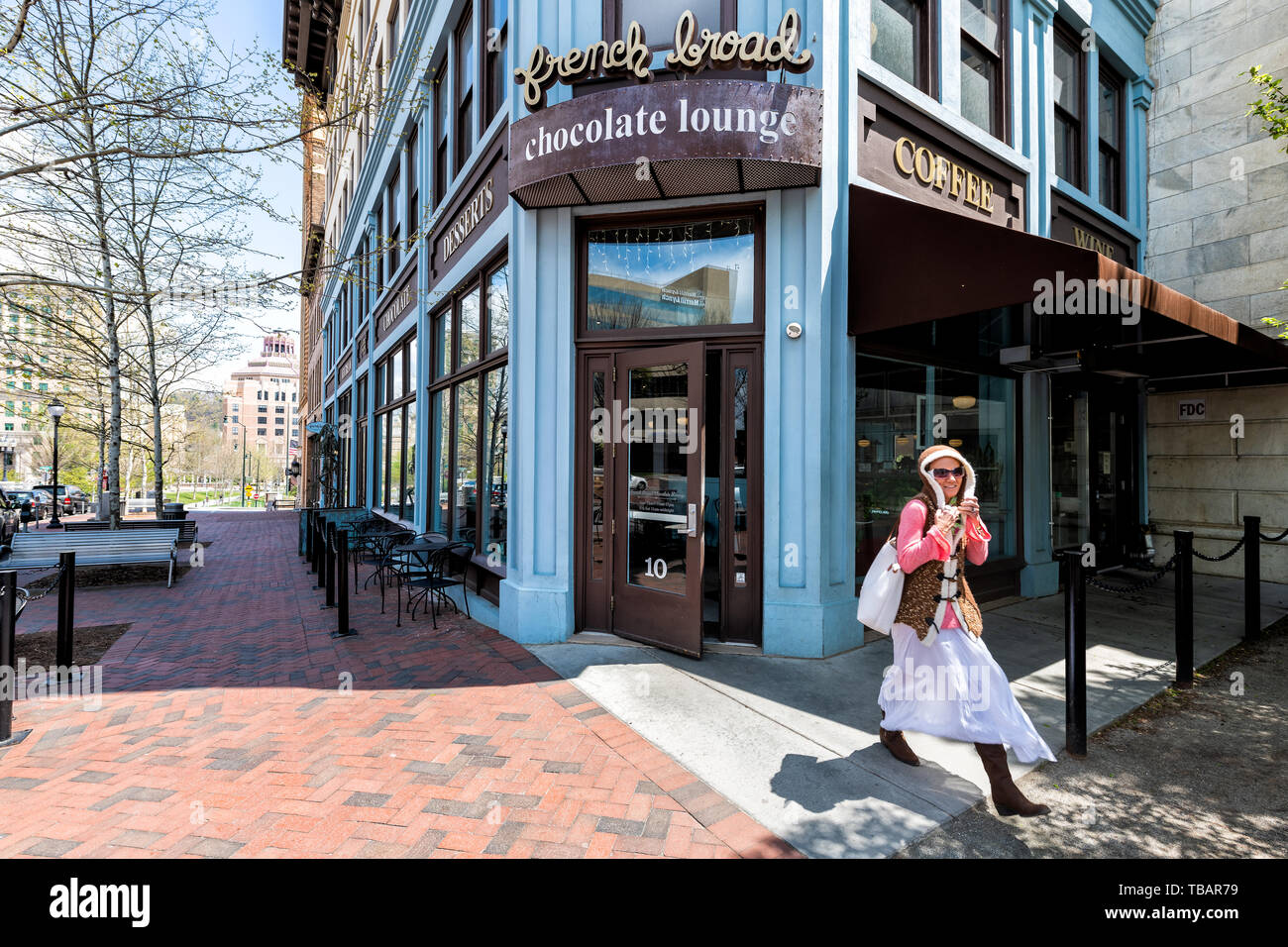 Asheville, USA - April 19, 2018: Downtown old town street in North Carolina NC famous town with sign entrance to Chocolate Lounge and woman walking - Stock Image