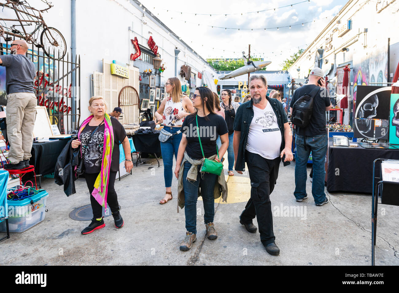 New Orleans, USA - April 22, 2018: Decatur street in Louisiana famous city and antique outdoor art store with people shopping - Stock Image