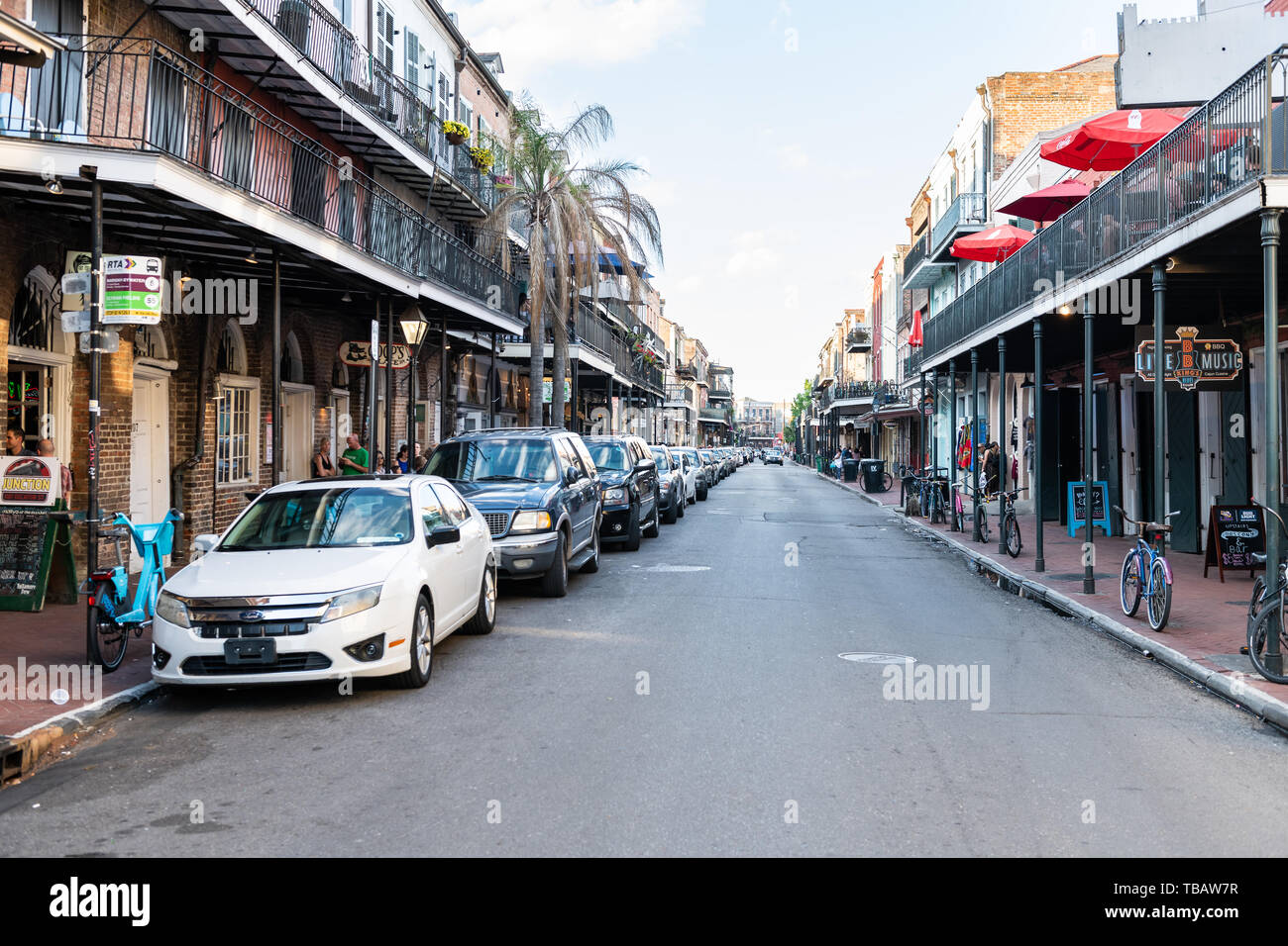New Orleans, USA - April 22, 2018: Old town Decatur street in Louisiana city with cars parked during evening - Stock Image
