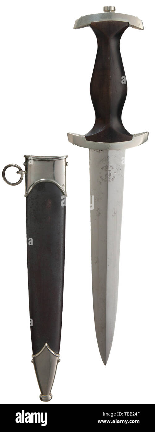 """THE JOHN PEPERA COLLECTION, A M 1933 SS service dagger, maker Robert Klaas, Solingen, Polished blade (spotted) with etched motto and manufacturer's logo. Nickel silver hilt fittings, lower reverse cross-guard district stamped """"III"""". Black ebony wooden grip with inset nickel silver eagle and enamelled SS-emblem. Service worn black burnished steel scabbard (light corrosion and one minor dent to reverse) with nickel silver fittings (very minor dent to lower ball). Length 37.5 cm, Editorial-Use-Only Stock Photo"""