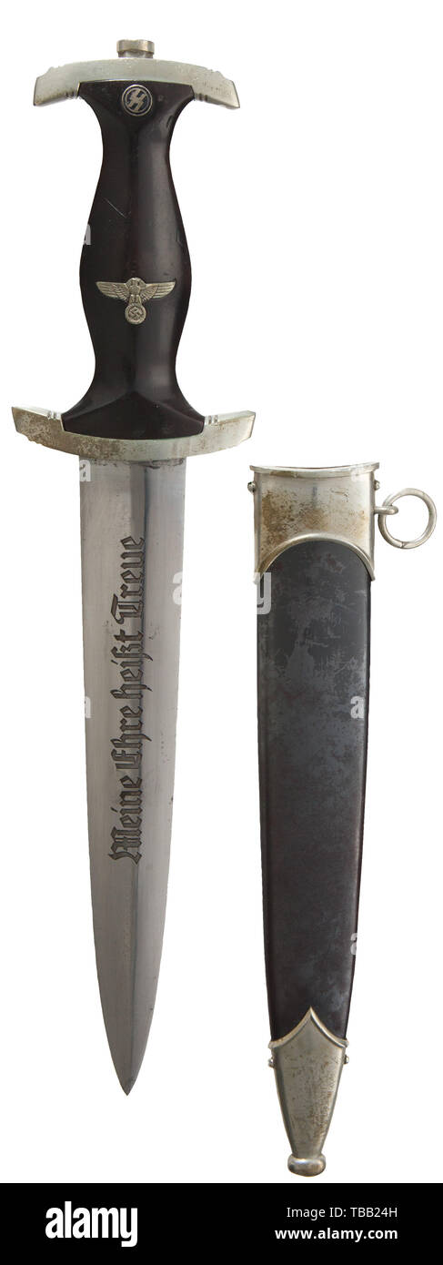 """THE JOHN PEPERA COLLECTION, A M 1933 SS service dagger, maker Böker, Solingen, Polished blade (minor aging) with etched motto and manufacturer's logo. Nickel silver hilt fittings, lower reverse cross-guard district stamped """"I"""". Black ebony wooden grip with inset nickel silver eagle and enamelled SS-emblem. Service worn black burnished steel scabbard with minor traces of lacquer and nickel silver fittings (minor dent lower ball). Length 37.5 cm., Editorial-Use-Only Stock Photo"""