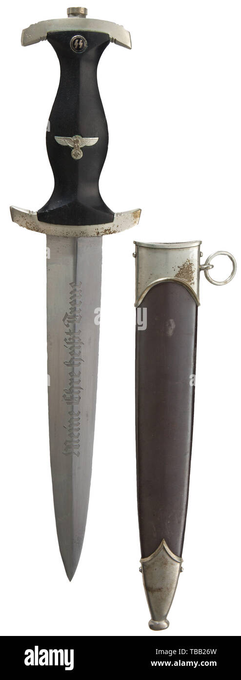 "THE JOHN PEPERA COLLECTION, A M 1934 SS honour dagger with ground Röhm dedication, maker Gottlieb Hammesfahr, with no. 50782, Polished blade (minor aging) with etched motto and manufacturer's logo, reverse surface with grinding resulting from removal of the inscription due to regulations. Nickel silver hilt fittings, lower reverse cross-guard district stamped ""III"" over-stamped with SS member number ""50782"". Black ebony wooden grip (minor aging) with inset nickel silver eagle and enamelled SS-emblem. Service worn burnished steel scabbard with nickel silver fittings (minor d, Editorial-Use-Only Stock Photo"