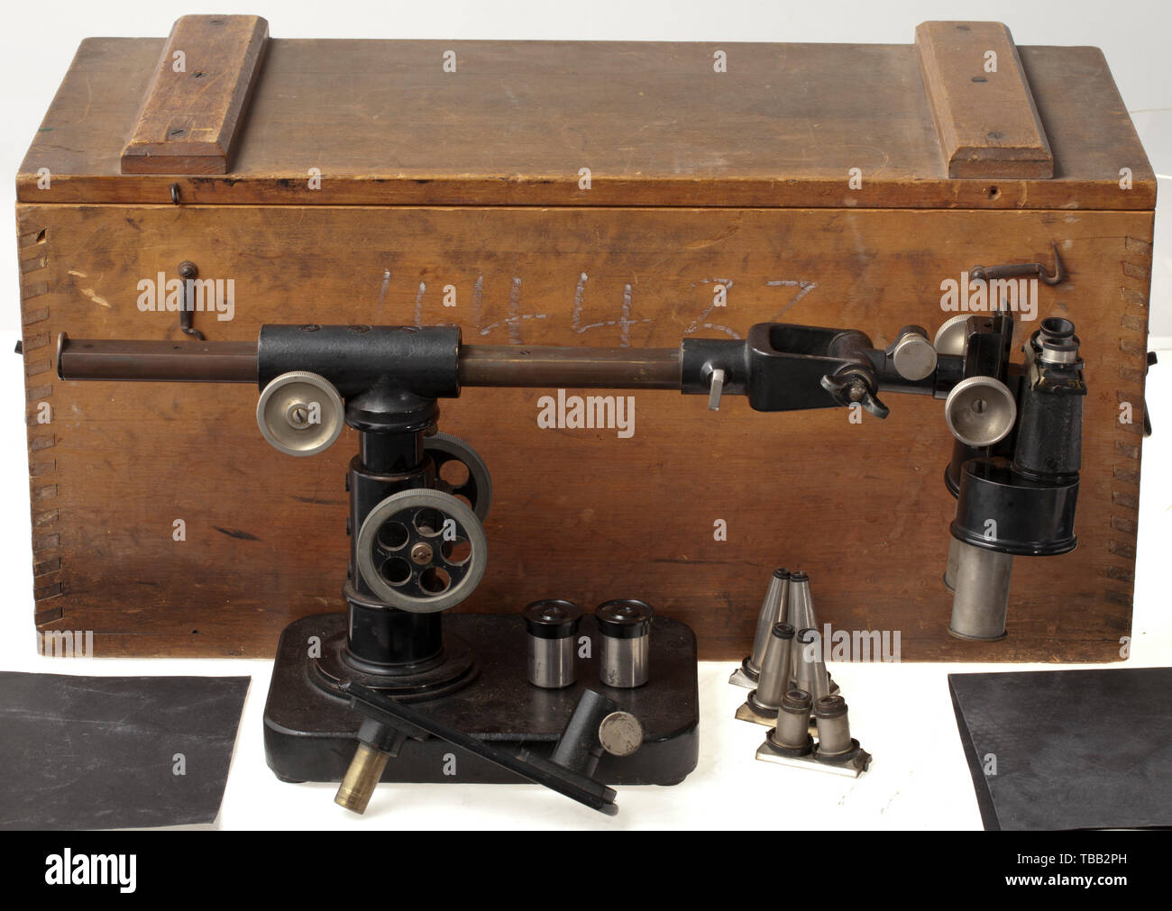 """A special microscope and photo viewer by Zeiss The viewer with the acceptance stamp of the imperial navy, """"Nr. 44433"""" and maker's inscription """"Carl Zeiss, Jena"""". Mounted on a steel panel, multi-adjustable in height and acuity. In corresponding wood transportation box with accessories such as replacement lenses, illegible inventory stamp. Probably used for the analysis of aerial shots. historic, historical, navy, naval forces, military, militaria, branch of service, branches of service, armed forces, armed service, object, objects, stills, clippin, Additional-Rights-Clearance-Info-Not-Available Stock Photo"""