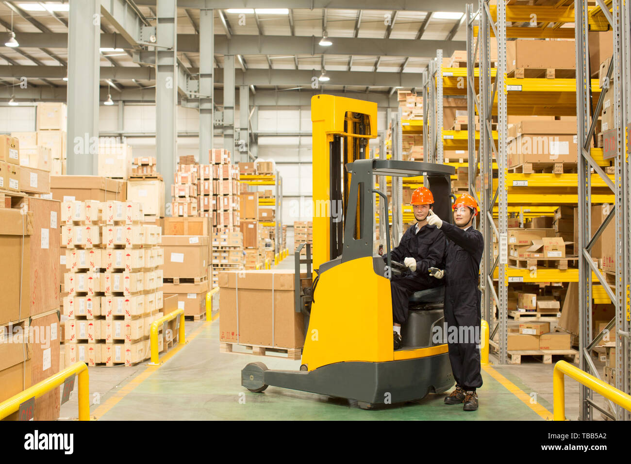 Logistics personnel load and unload cargo at the warehouse Stock Photo