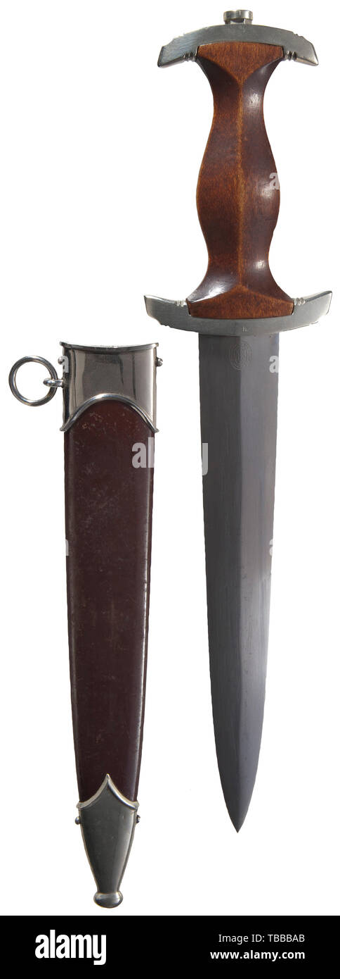 """THE JOHN PEPERA COLLECTION, A M 1934 SA Honour Dagger with ground Röhm Dedication, Maker Carl Eickhorn, Solingen. Polished blade (minor aging) with etched motto and manufacturer's logo, reverse surface with traces of grinding resulting from removal of the inscription due to regulations. Nickel silver hilt fittings, lower reverse crossguard stamped """"He"""" for SA Group Hessen and underside stamped with inspector number """"0"""". Brown wooden grip with inset nickel silver eagle and enamelled SA emblem. Burnished (thinning) steel scabbard with lacquer and nickel silver fittings. Lengt, Editorial-Use-Only Stock Photo"""
