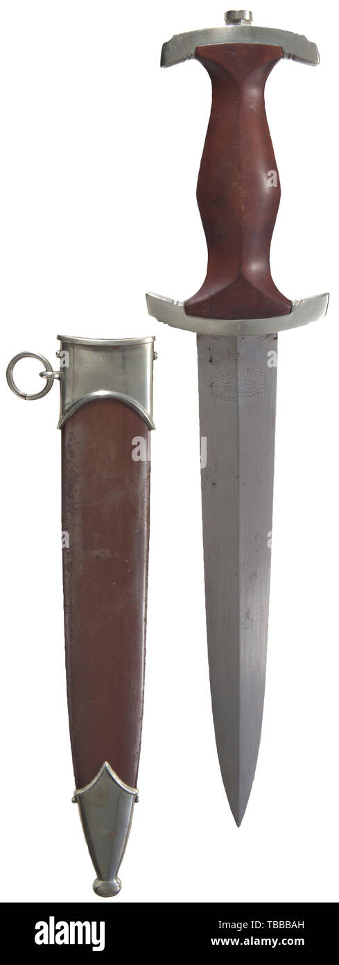 """THE JOHN PEPERA COLLECTION, A M 1933 SA Service Dagger, Maker Hammesfahr & Cie, Solingen. Polished blade (significant scratching) with etched motto and manufacturer's logo. Nickel silver hilt fittings, lower reverse crossguard stamped """"S"""" for SA Group Schlesien. Brown wooden grip (minor aging) with inset nickel silver eagle and enamelled SA emblem. Burnished steel scabbard with lacquer (thinning) and nickel silver fittings. Length 37.5 cm., Editorial-Use-Only Stock Photo"""